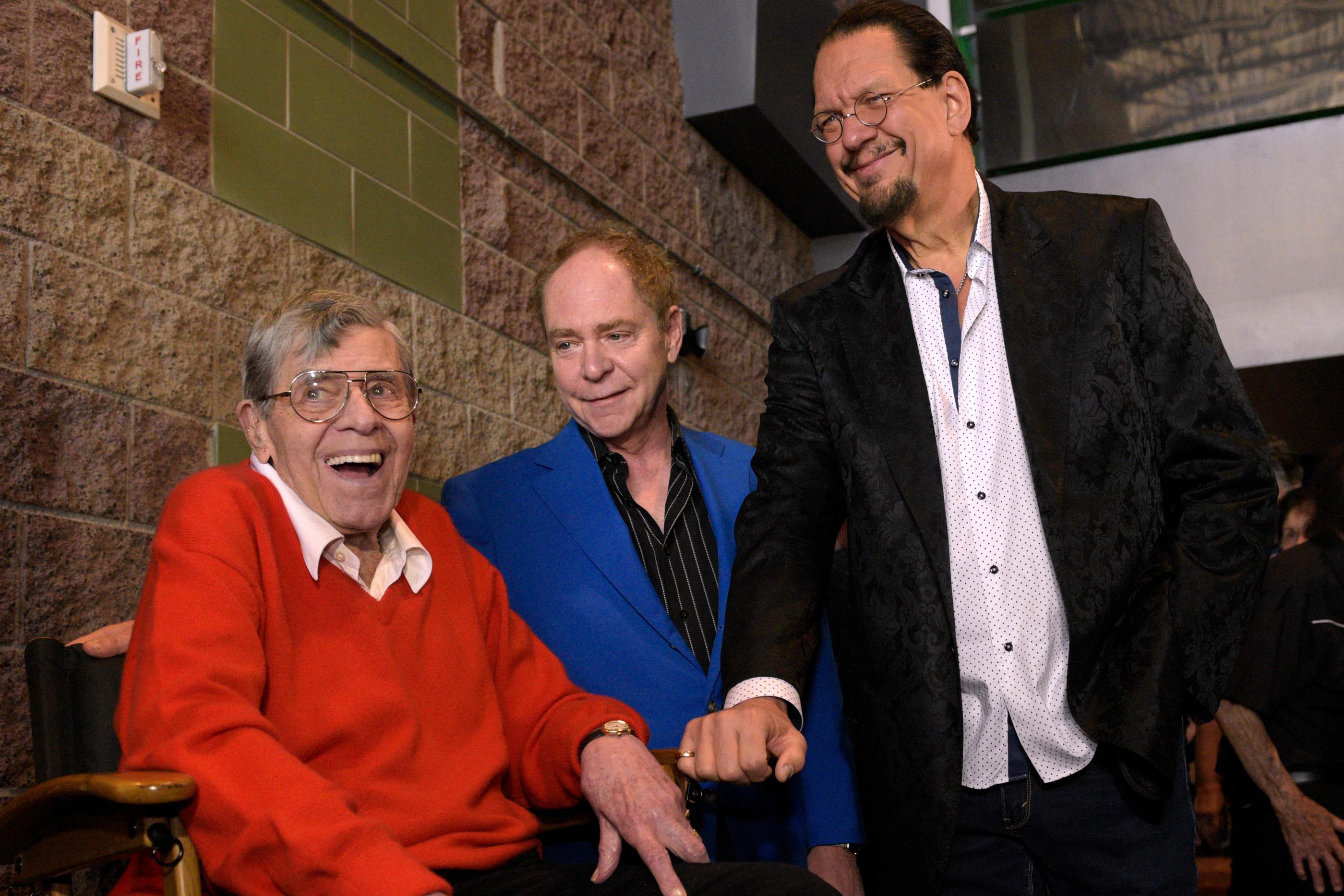 "Jerry Lewis, left, talks with magicians Penn Jillette, right,  and Teller before a preview of his new film ""Max Rose"" Saturday, Sept. 24, 2016 at Regal Village Square Cinemas in Las Vegas. (Sam Morris/Las Vegas News Bueau)"