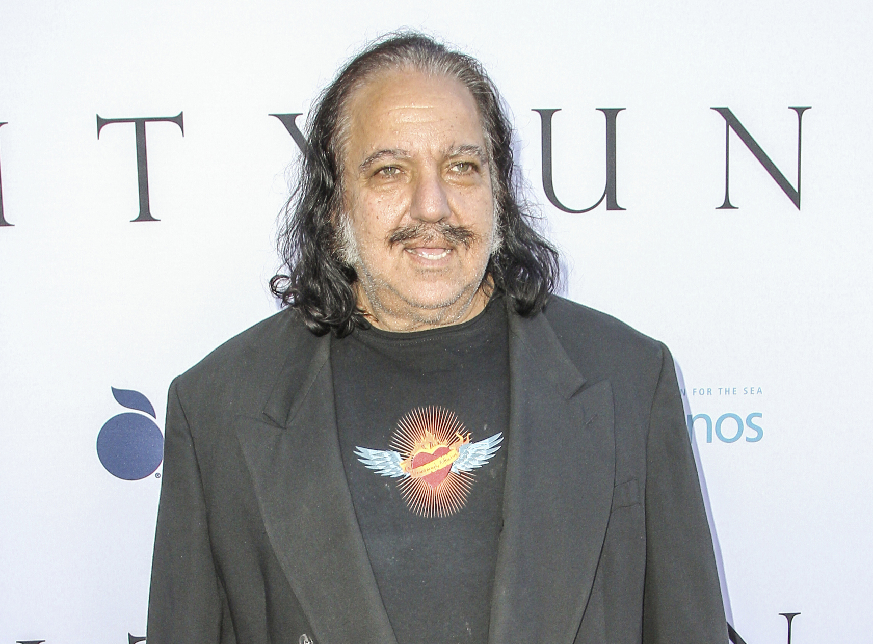 "FILE - In this June 24, 2015 file photo, adult film actor Ron Jeremy attends the world premiere of ""Unity"" in Los Angeles. Jeremy has been charged with raping three women and sexually assaulting a fourth.  (Photo by Paul A. Hebert/Invision/AP, File)"