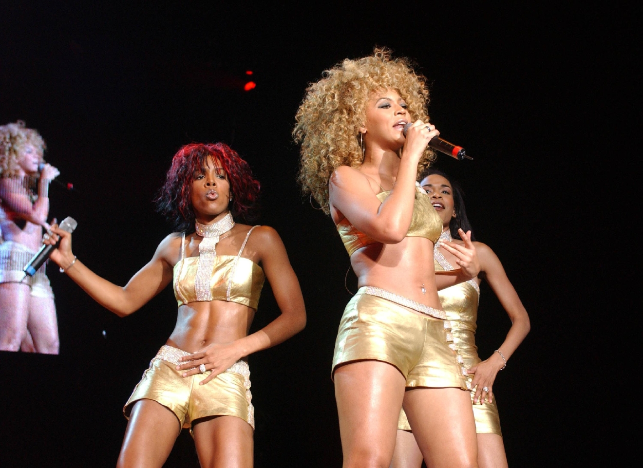 Michelle Williams, Beyonce Knowles and Kelly Rowland Destiny's Child performing at London Arena London, England - 07.06.02  Where: London, United Kingdom When: 07 Jun 2002 Credit: WENN