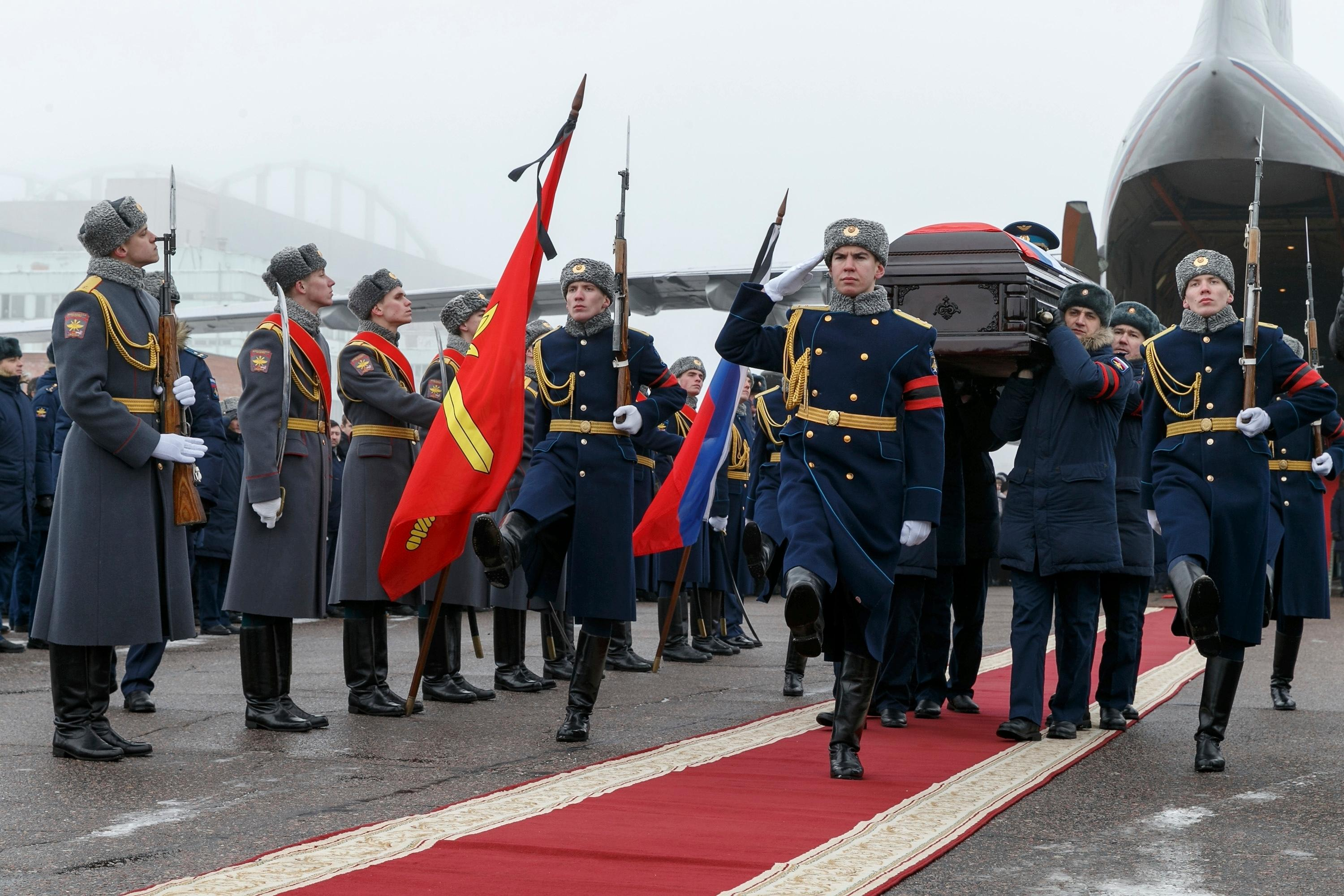 Russian officers carry a coffin with the body of Russian Roman Filipov, the pilot of the Su-25 jet who ejected after Syrian insurgents shot down his plane traded fire with militants on the ground and then blew himself up to avoid being captured, during a funeral service in Voronezh, Russia, Thursday, Feb. 8, 2018. (Vadim Savitsky/Pool Photo via AP)