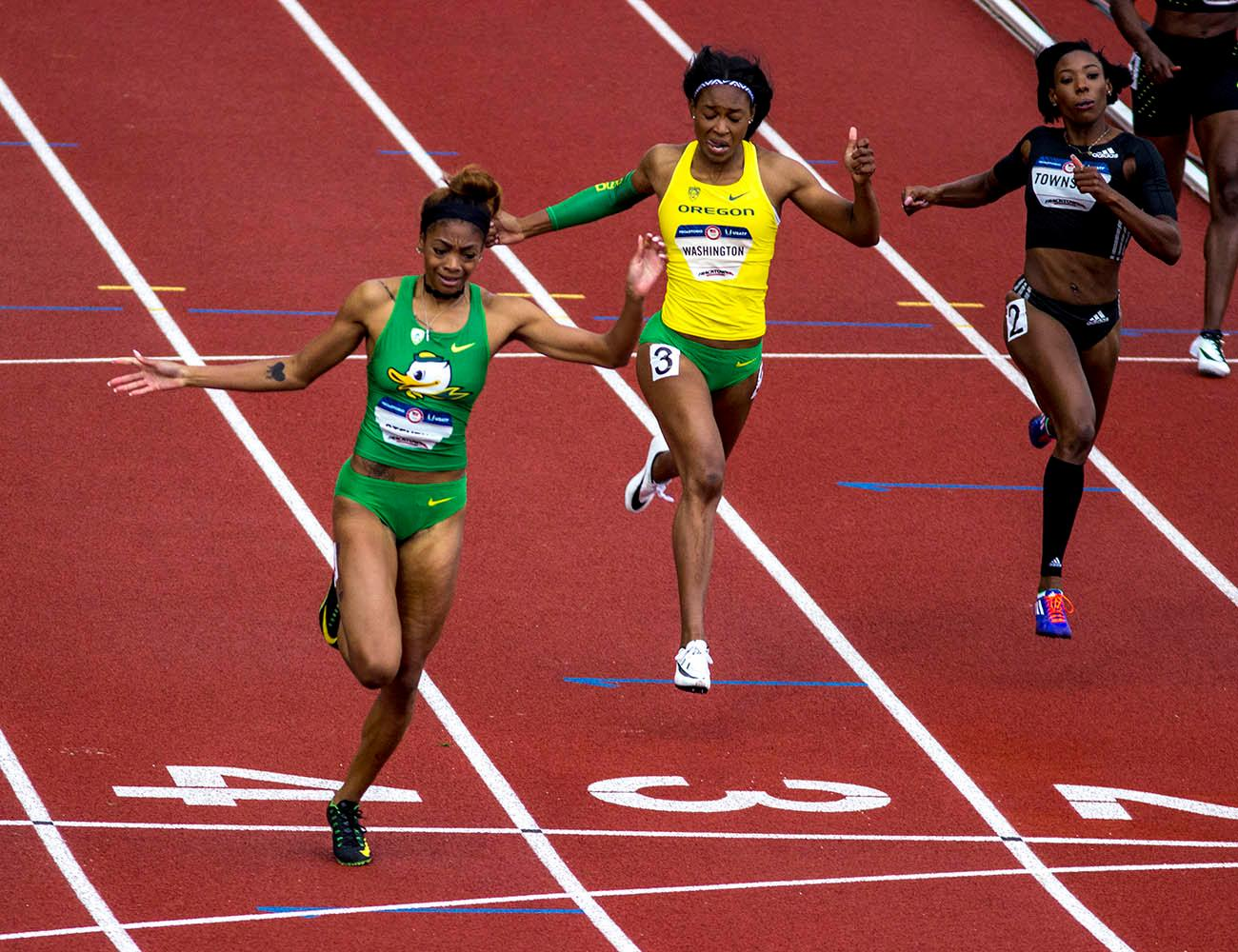 From left to right, Deajah Stevens, Ariana Washington and Tiffany Townsend cross the finish line in the Women�s 200m Dash. Stevens finished second with a time of 22.30. Washington finished fifth with a time of 22.65. Townsend finished seventh with a time of 22.80. Day 10 of the U.S. Track and Field Trials concluded Sunday at Hayward Field in Eugene, Ore. The competition lasted July 1 through July 10. Photo by Amanda Butt