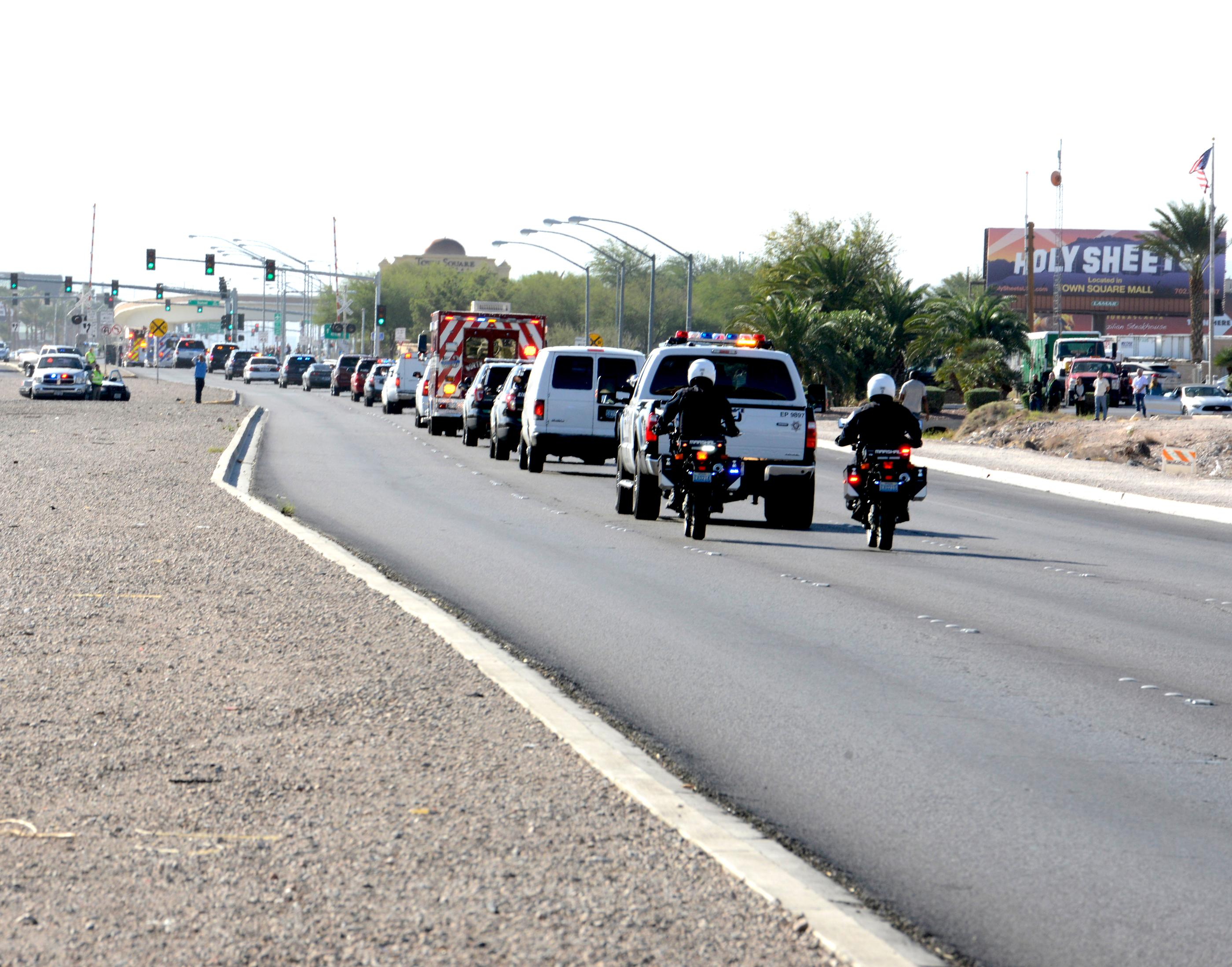 A police motorcade escorts fallen Las Vegas Metro Officer Charleston Hartfield and his family down the Las Vegas Strip and out to the Central Church located at 1001 New Beginnings Drive in Henderson. Friday, October 20, 2017. CREDIT: Glenn Pinkerton/Las Vegas News Bureau