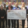 Fiesta Foods donates check to Yakima School District for student attendance programs
