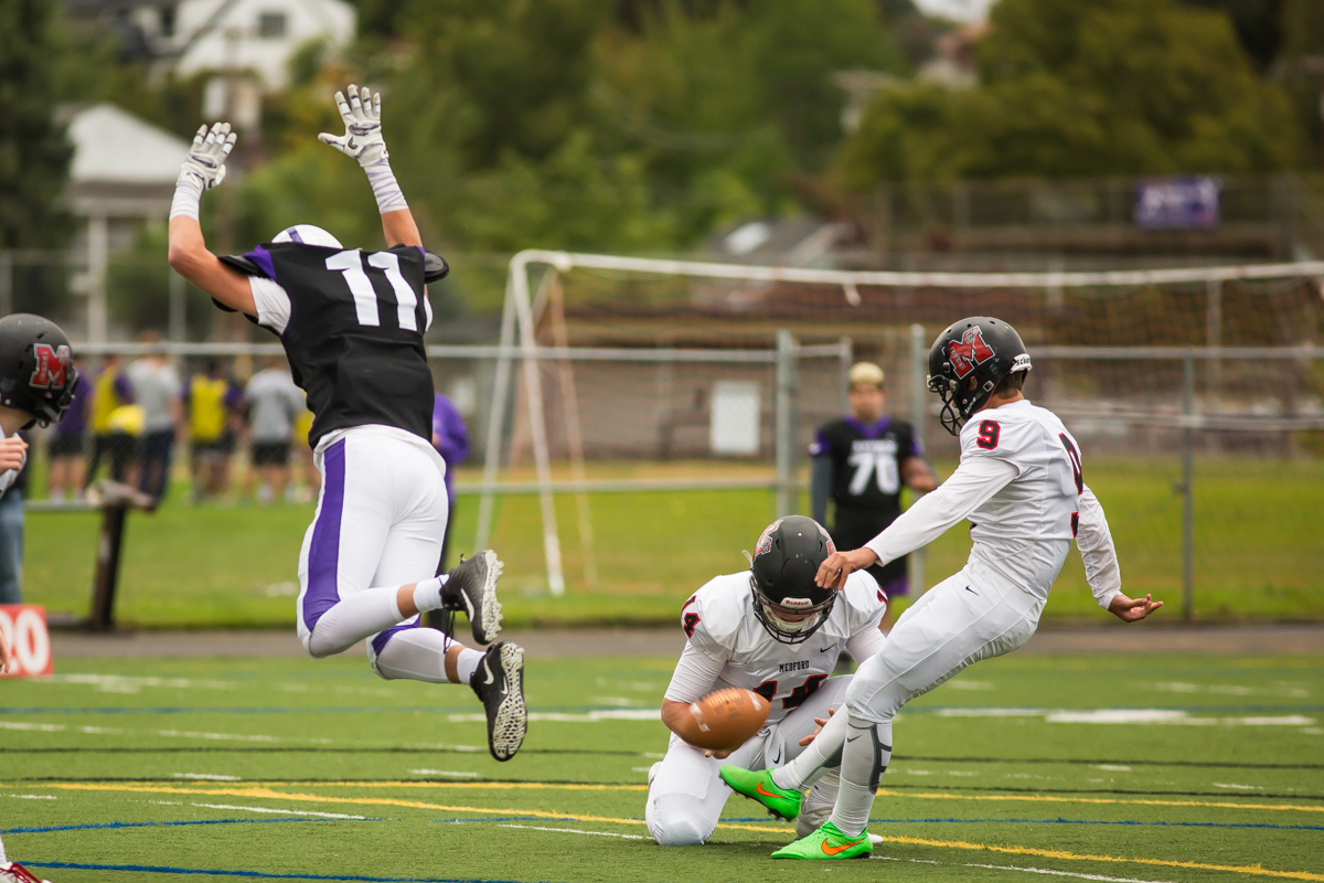 South Eugene safety Luke MacArthur (#11) attempts to block a field goal. The game had been postponed from Friday due to unhealthy levels of smoke in the atmosphere due to nearby forest fires. Photo by Dillon Vibes