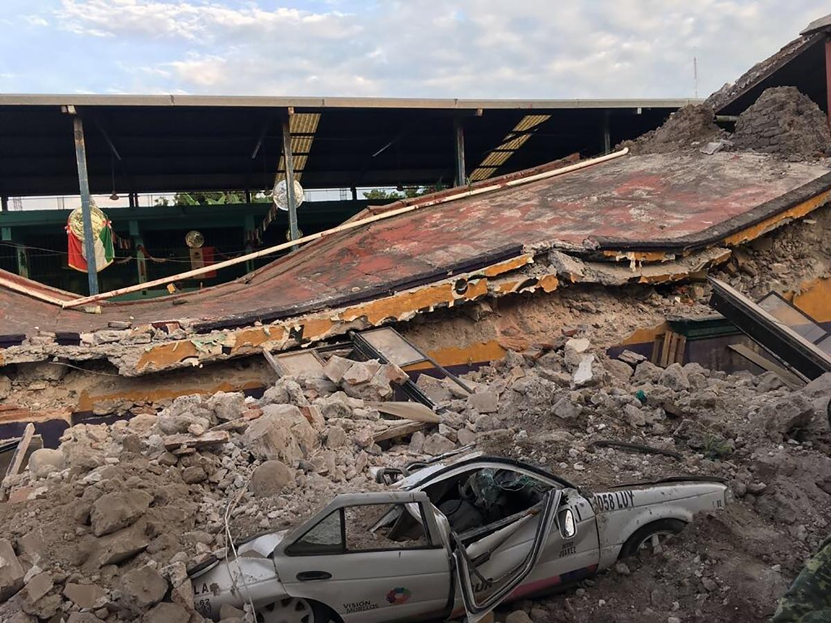A car sits crushed, engulfed in a pile of rubble from a building felled by a 7.1 earthquake, in Jojutla, Morelos state, Mexico, Tuesday, Sept. 19, 2017. The earthquake stunned central Mexico, killing at least 139 people as buildings collapsed in plumes of dust. (AP Photo/Carlos Rodriguez)