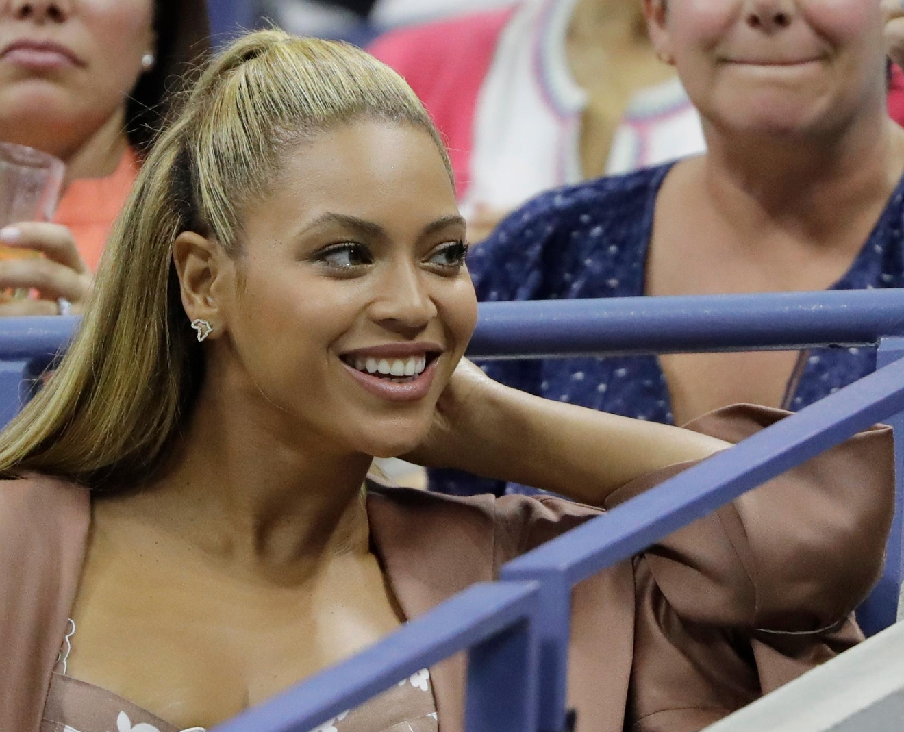 Beyonce watches the match between Serena Williams and Vania King during the second round of the U.S. Open tennis tournament, Thursday, Sept. 1, 2016, in New York. (AP Photo/Darron Cummings)