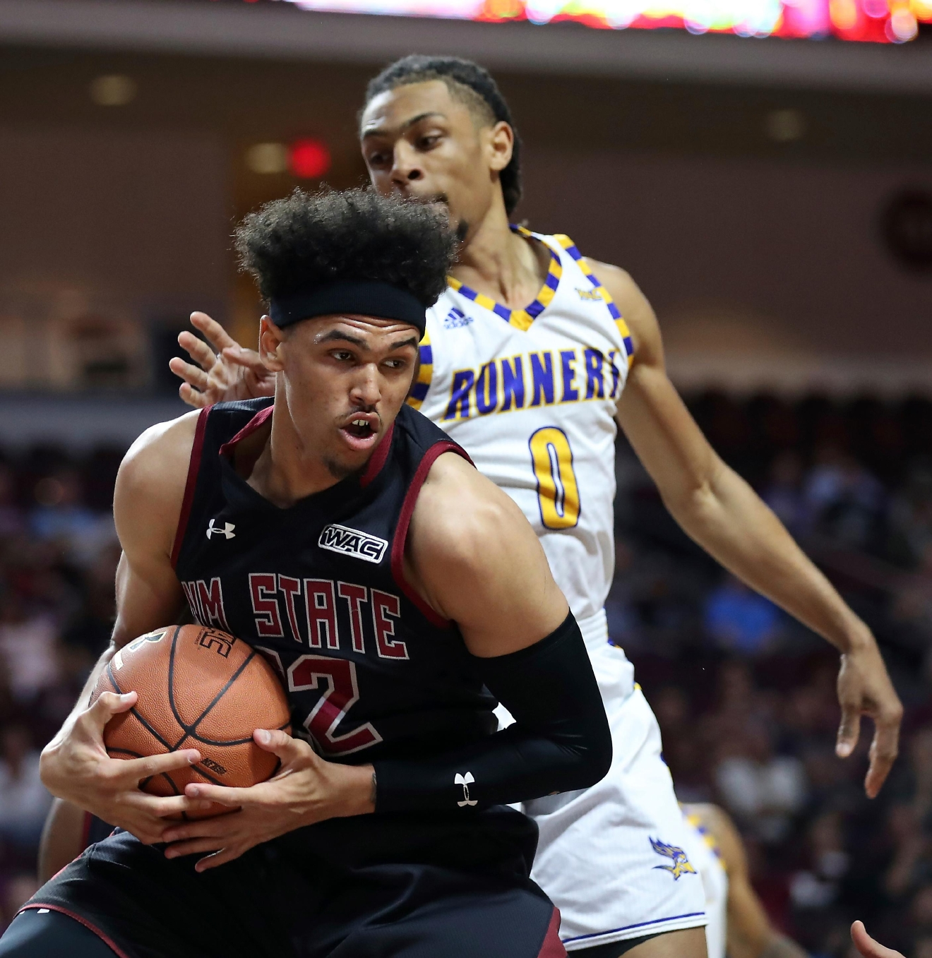 New Mexico State forward Eli Chuha (22) secures the ball with Cal State Bakersfield forward Matt Smith (0) defending during the second half of their NCAA college basketball game in the final of the Western Athletic Conference tournament Saturday, March 11, 2017, in Las Vegas. New Mexico State won 70-60. (AP Photo/L.E. Baskow)