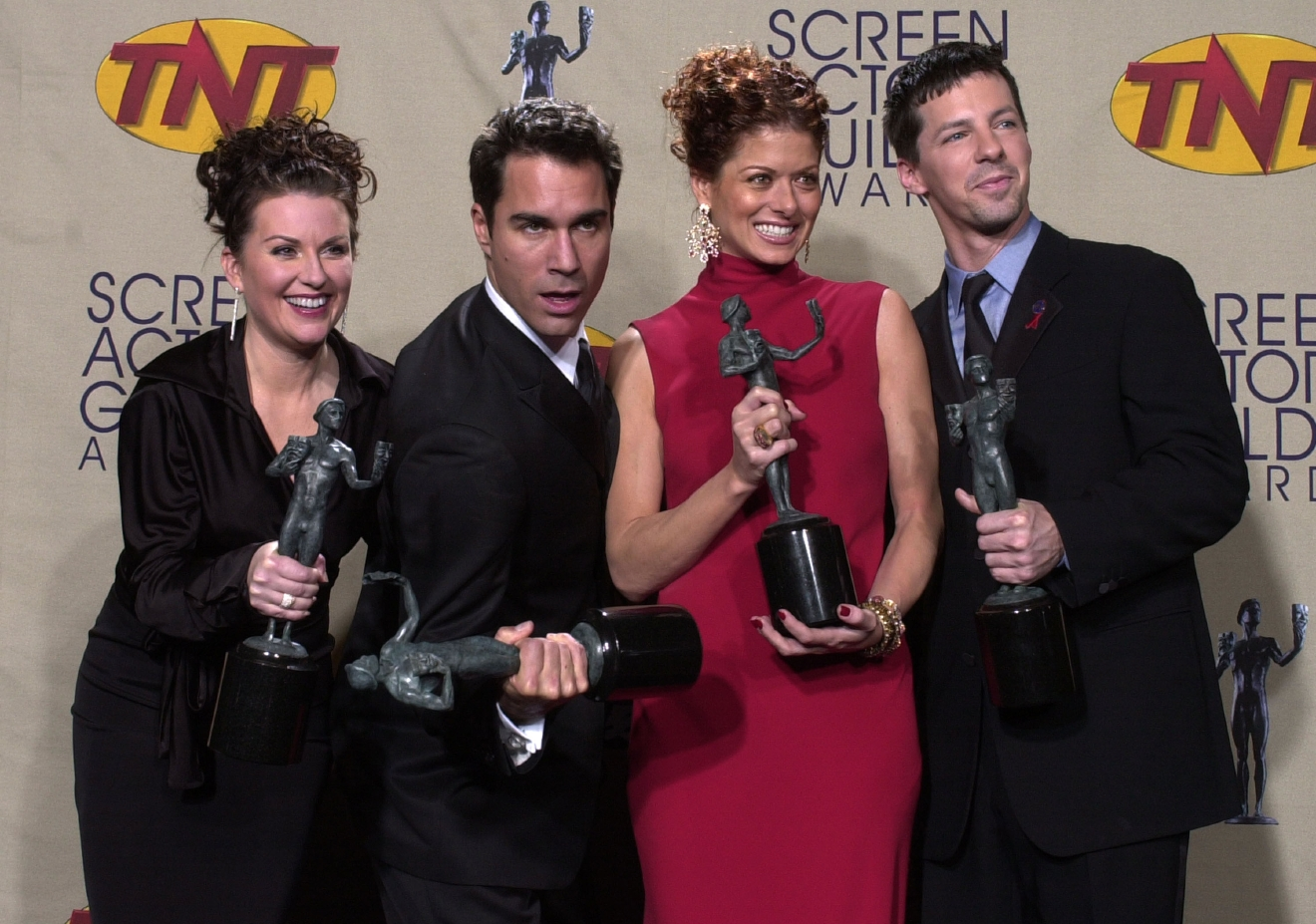 "The cast of television's ""Will & Grace,"" from left, Megan Mullally, Eric McCormack, Debra Messing and Sean Hayes pose with their awards for outstanding performance by an ensemble in a comedy series at the 7th annual Screen Actors Guild Awards in this photo taken March 11, 2001, in Los Angeles. (AP Photo/Reed Saxon)"