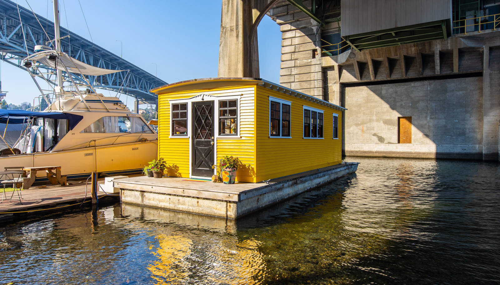 "This charming Limoncello houseboat on Lake Union has open water views of the University of Washington and is on the market for $259,000. It features an end-of-dock slip with room for a small boat, a river rock propane fireplace, built-in desk, dining nook, washer & dryer and a community garden. Listing by Alan Braden,{&nbsp;}<a  href=""https://www.rsir.com/homes-for-sale/3304-fuhrman-ave-e-10-seattle-wa-98102-1650484-1001782/"" target=""_blank"" title=""https://www.rsir.com/homes-for-sale/3304-fuhrman-ave-e-10-seattle-wa-98102-1650484-1001782/"">more info online</a>. (Image: Nicolas Gerlach /{&nbsp;}<a  href=""https://www.instagram.com/apnwphotographer/"" target=""_blank"" title=""https://www.instagram.com/apnwphotographer/"">@apnwphotographer</a>){&nbsp;}"