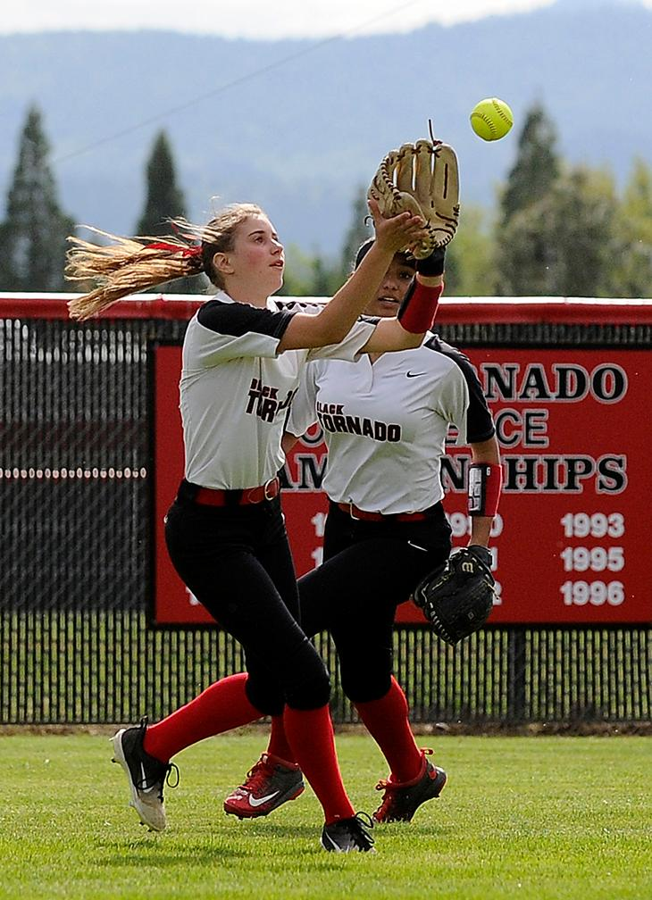 Andy Atkinson / Mail TribuneNorth's Grace Johnson makes a catch in left field to close out South in the 1st inning.