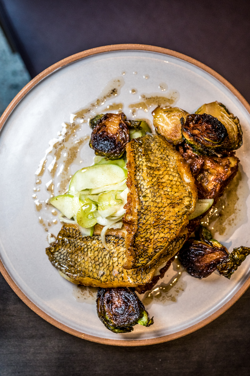Atlantic Black Bass: potato waffle, apple slaw, brussels sprouts, and brown butter agrodolce / Image: Catherine Viox{ }// Published: 11.18.20