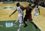 Cleveland Cavaliers' LeBron James shoots past Milwaukee Bucks' Sterling Brown during the first half of a game Tuesday, Dec. 19, 2017, in Milwaukee.