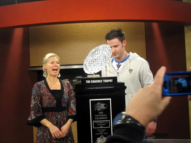 Denise Phillips and Brian White get their picture taken wiith the BCS trophy.