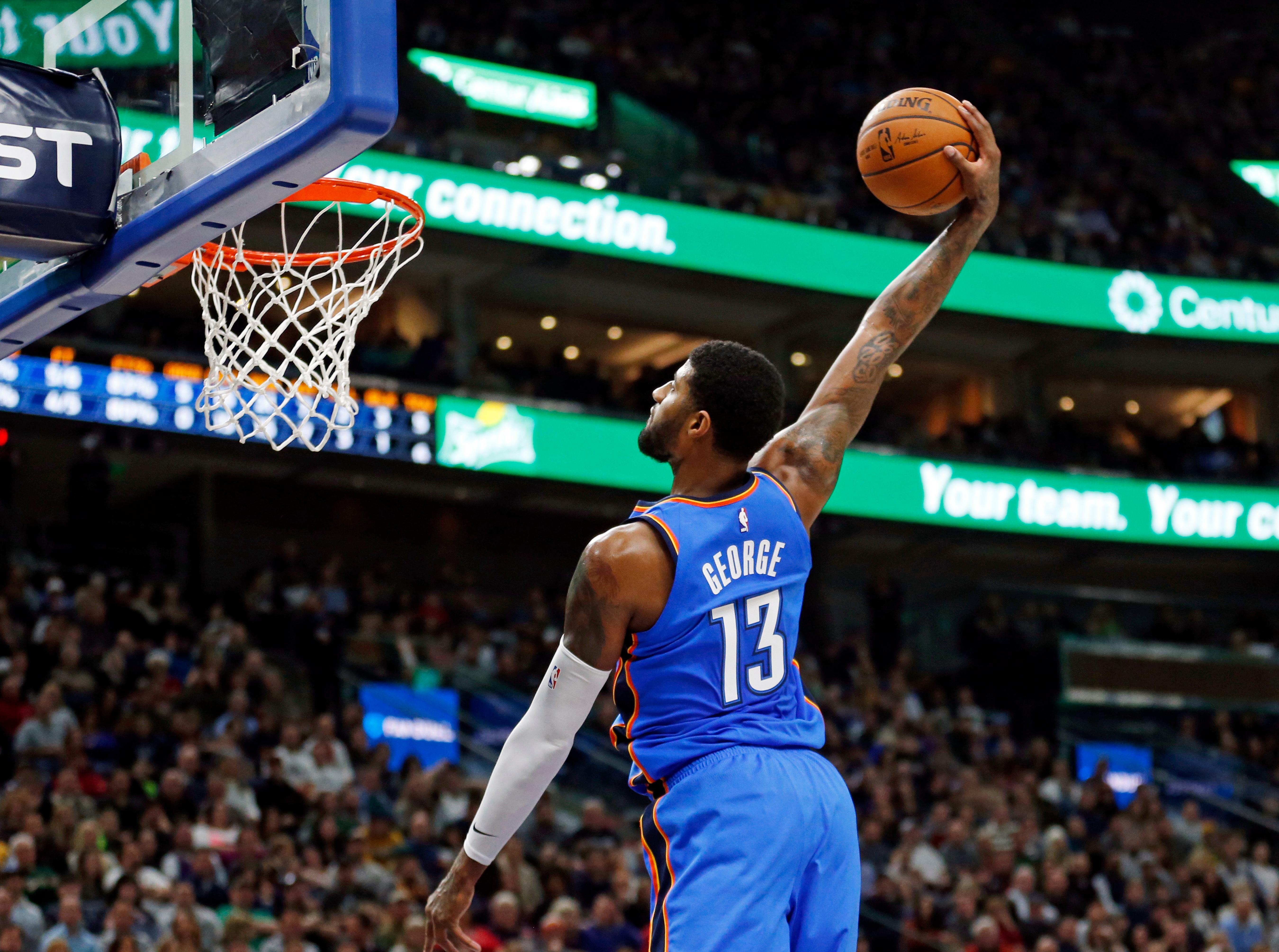 Oklahoma City Thunder forward Paul George (13) dunks against the Utah Jazz in the first half during an NBA basketball game Saturday, Dec. 23, 2017, in Salt Lake City. (AP Photo/Rick Bowmer)
