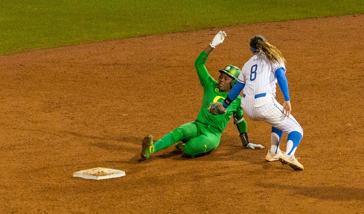 The University of Oregon Ducks shortstop DJ Sanders (#37) attempts to slide under the tag of UCLA Bruins Kylee Perez (#8). The University of Oregon Ducks softball pitcher Miranda Elish held the UCLA Bruins scoreless for five innings as the Ducks put seven runs on the board. The Bruins rallied with a two-run homer in the sixth and a three-run home run in the seventh, but the Ducks held on and beat undefeated UCLA 7-5 at Jane Sanders Stadium Saturday. The Ducks improved their record to 24-5. Photo by William Tierney, Oregon News Lab