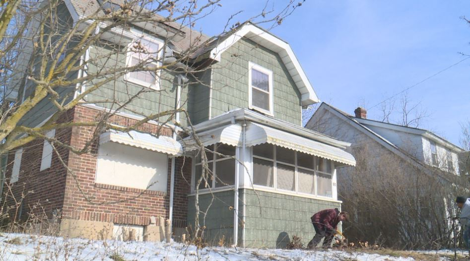 A local group in Flint took advantage of the warm weather to beautify houses. (WEYI){ }
