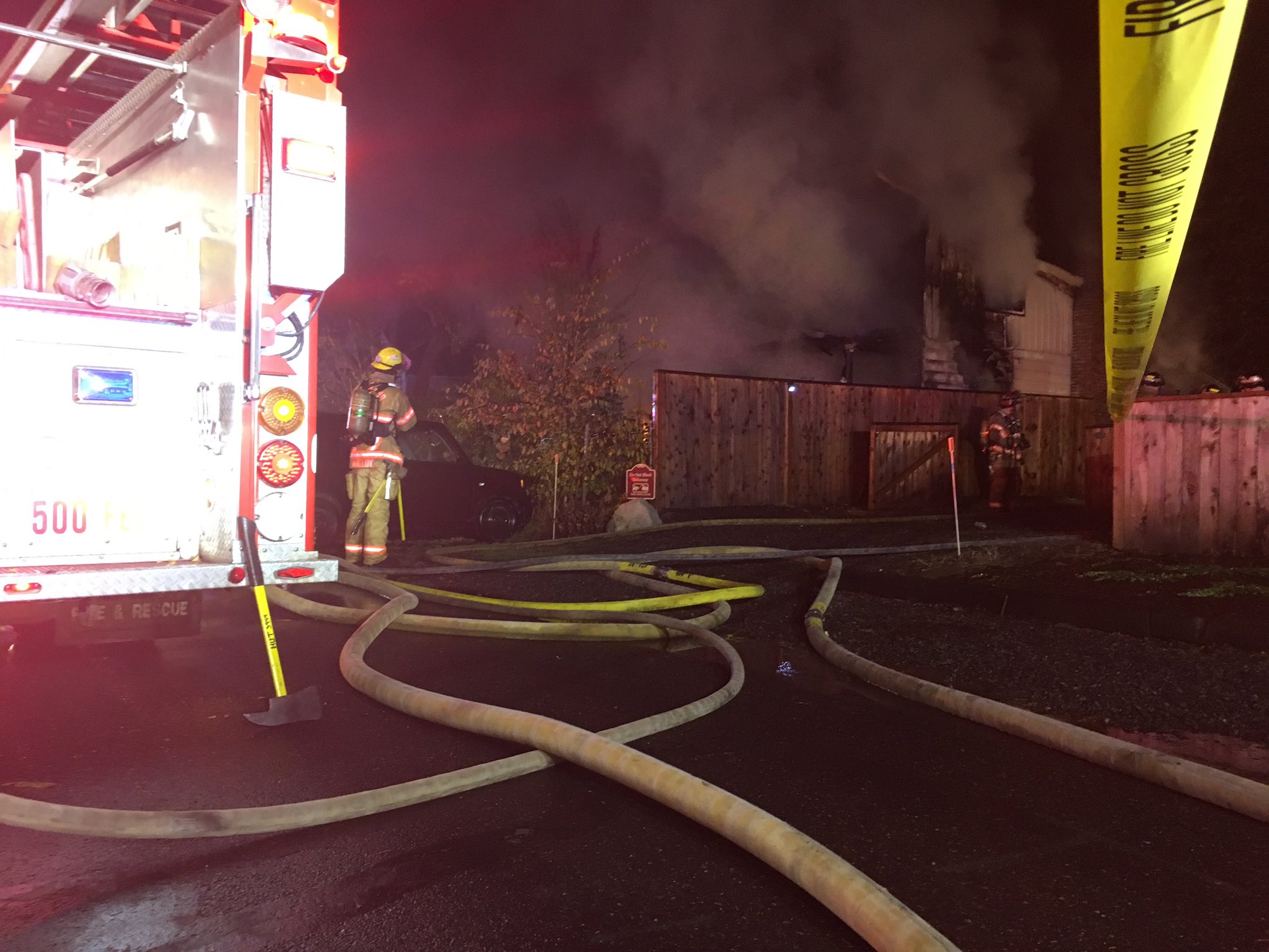 A house fire in the 5000 block of NE Alberta Court caused officials to close the road on Friday, Oct. 13, 2017. (SBG photo)