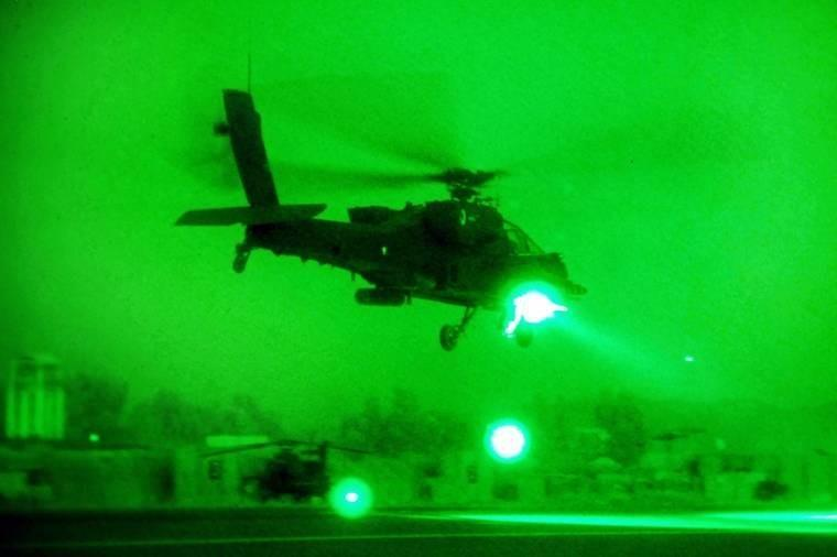 As seen through a night-vision device, an AH-64 Apache helicopter departs Forward Operating Base Fenty, Afghanistan, to conduct a security and reconnaissance mission. The crew is assigned to the 1st Battalion Attack, 10th Combat Aviation Brigade.