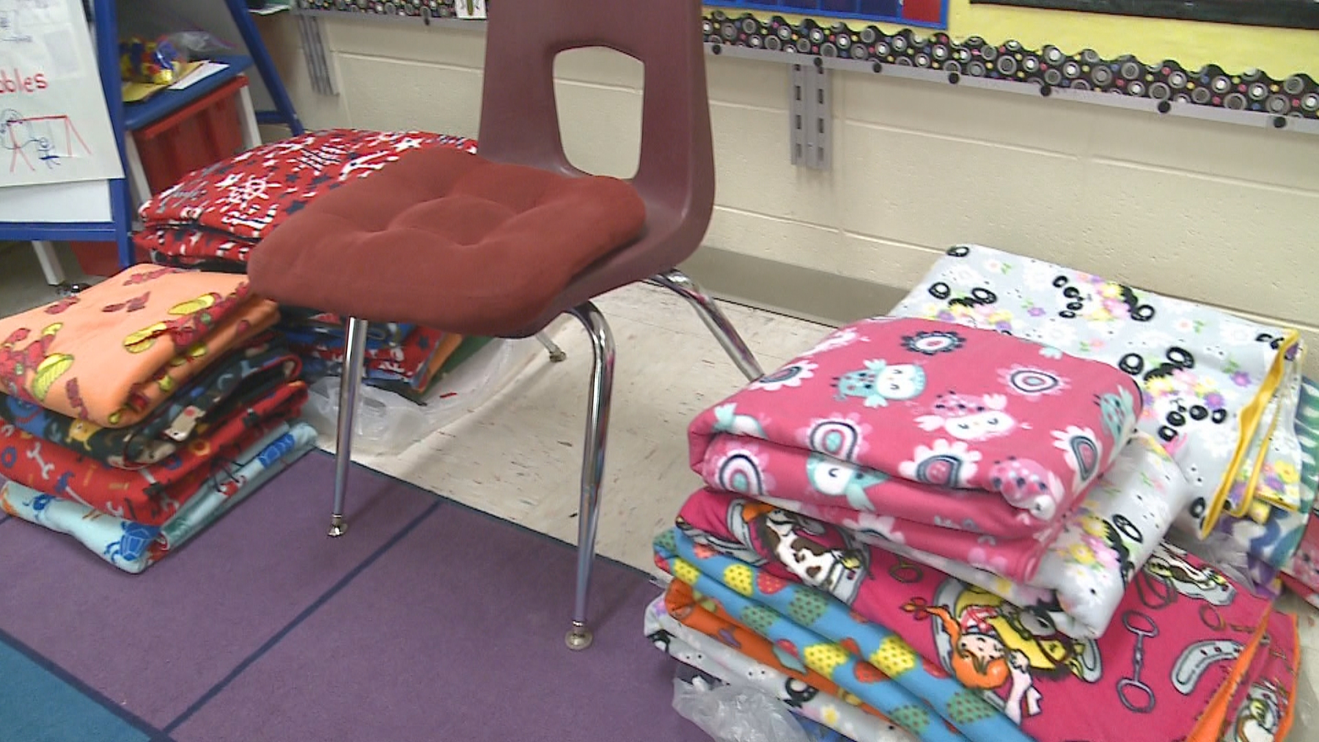 Grace Treml donated blankets she made to students at Howe Elementary School in Green Bay, January 3, 2018. (WLUK)