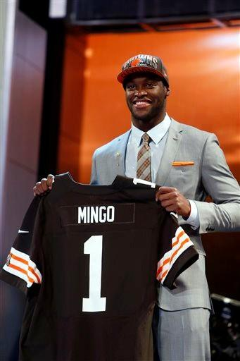 Defensive end Barkevious Ming from Louisiana State holds up the team jersey after being selected sixth overall by the Cleveland Browns in the first round of the NFL football draft, Thursday night.
