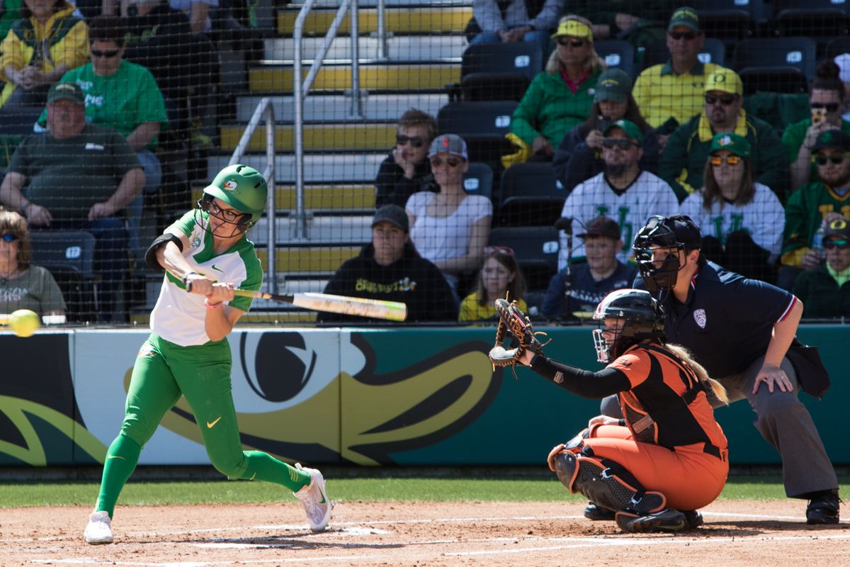 Oregon Ducks right fielder Danica Mercado (#2) starts her swing on an incoming pitch. The Oregon Ducks defeated the Oregon State Beavers seven to zero on Sunday, April 30, 2017. The Ducks' victory marked the third victory of the three game sweep against the Beavers. Photo by Austin Hicks, Oregon News Lab