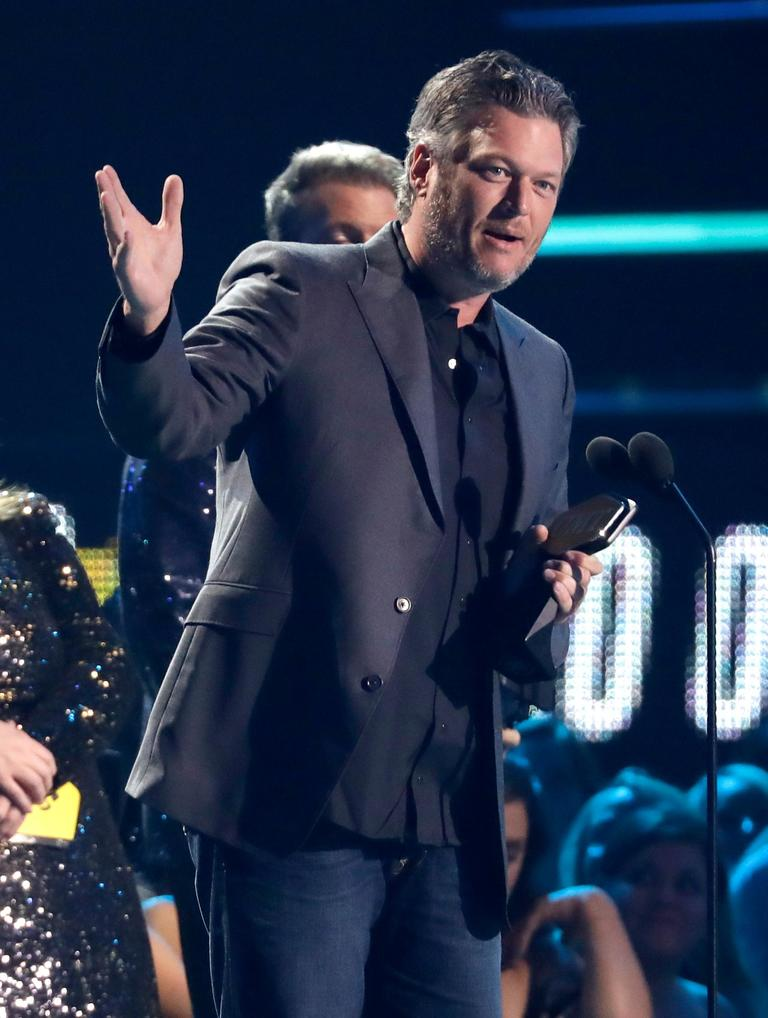 "Blake Shelton accepts the male video of the year award for 'l'll Name the Dogs"" (AP Photo/Mark Humphrey)"