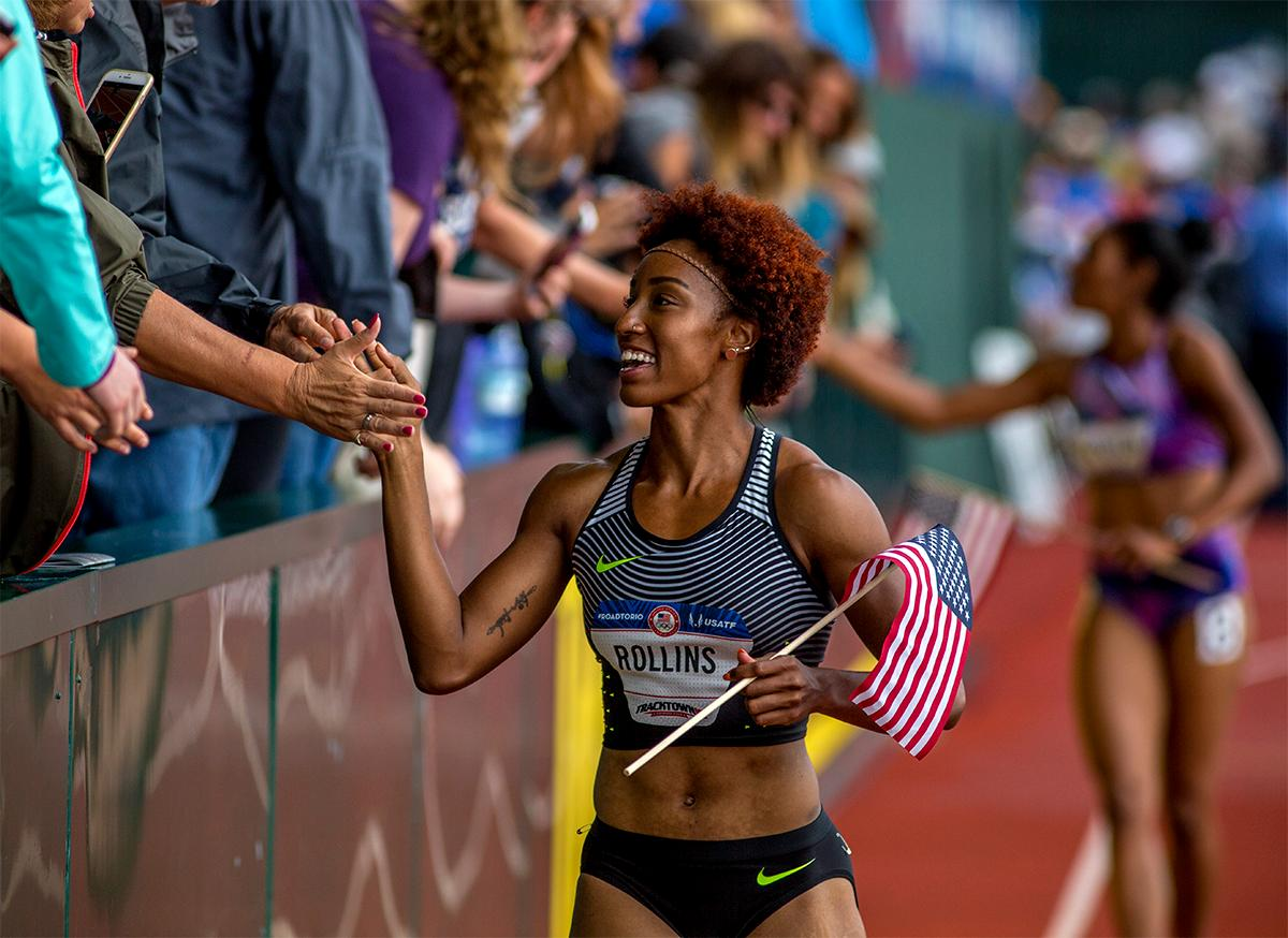 Nike's Brianna Rollins high fives fans on her victory lap. Rollins won the 100 meter hurdles in 12.34 and will be headed for Rio next. Photo by August Frank, Oregon News Lab
