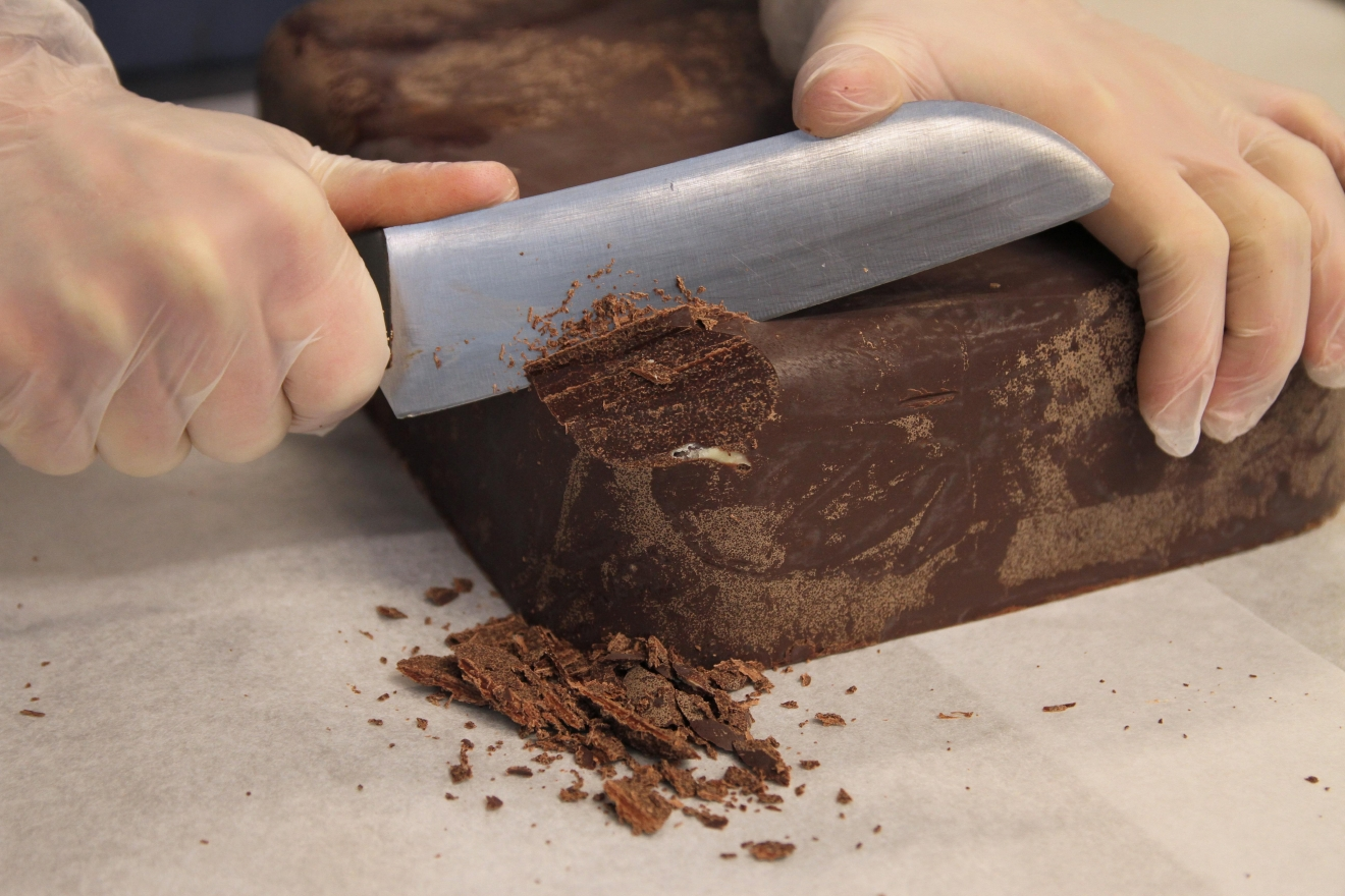 Untempered chocolate has a flaky texture, but Adam shaved some off. (Image: Amanda Andrade-Rhoades/ DC Refined)