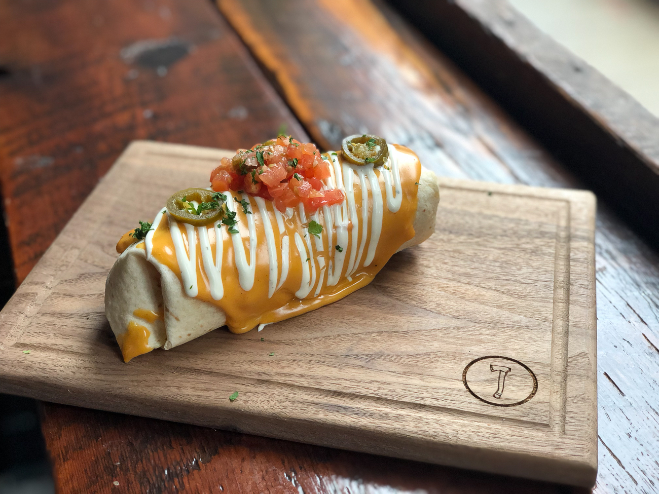 Breakfast Burrito: chorizo sausage, egg, cheese, and hash browns wrapped up in a tortilla, topped with queso, pico, ranch, and jalapenos / Image courtesy of Nation Kitchen and Bar // Published: 1.15.18