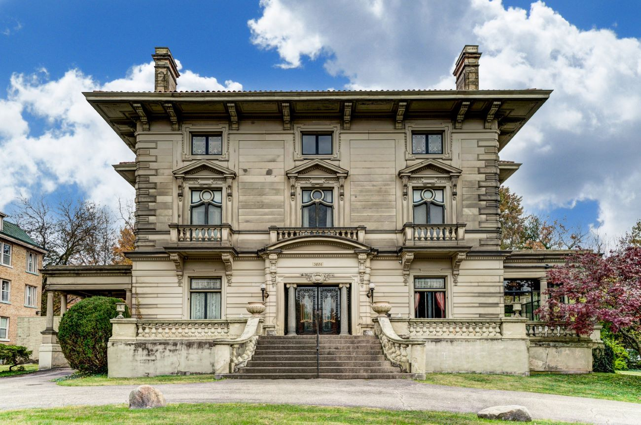 North Avondale's Herschede Mansion (3886 Reading Road) is a 7-bedroom, over-8,000-square-foot home that's currently on the market. It was designed in 1908 by Cincinnati architect Samuel S. Godley in a Greek/Italian Renaissance Revival design for jeweler and clockmaker Frank Herschede and his family of 10. The property sits on a .72-acre lot that's just five minutes from the Cincinnati Zoo. It boasts 17 rooms in total, two full bathrooms, three half bathrooms, a detached 5-car garage, two solariums, a one-bedroom apartment with a kitchen, and a ballroom on the third floor. It's on the market for $575,000. You can find the listing at coldwellbanker.com. / Image: Adam Sanregret courtesy of Coldwell Banker West Shell // Published: 4.3.20