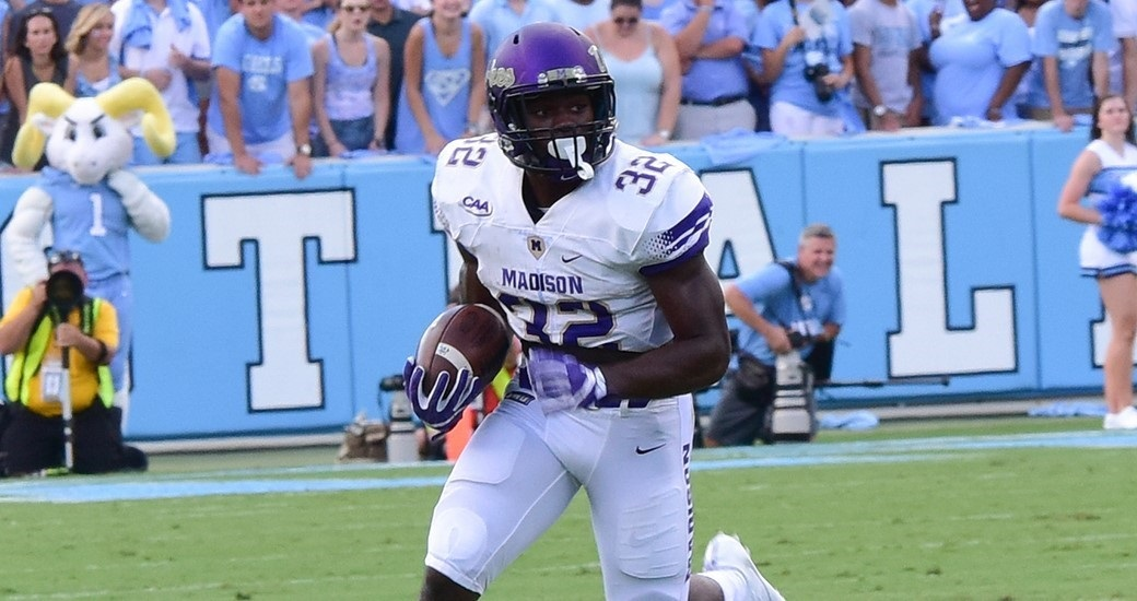 NORTH CAROLINA 56, JJMU 28: Khalid Abdullah (32) rushed for a game-high 116 yards and 2 touchdowns as JMU took a 21-14 lead in the first quarter. But after the Dukes piled up 222 total yards in the first 15 minutes, the Tar Heels took control and pulled away as QB Mitch Trubisky passed for a career-high 432 yards and 3 TDs. (Photo courtesy JMU Athletics)
