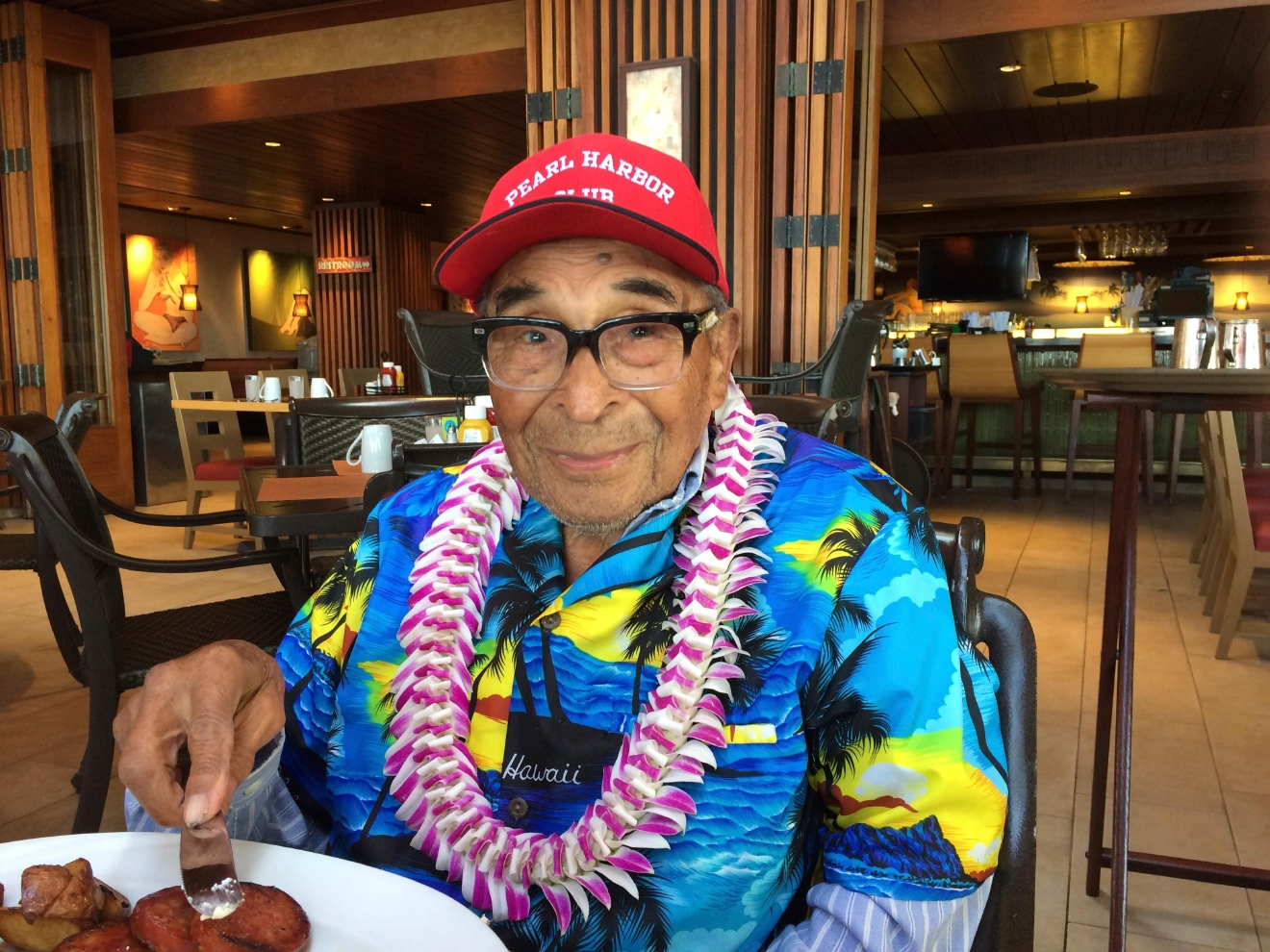 In this Monday, Dec. 5, 2016 photo, Ray Chavez, a Pearl Harbor survivor from Poway, Calif., pauses while eating breakfast in Honolulu. Chavez was out on a minesweeper, the USS Condor, in the early hours before the attack. Chavez is among a few dozen survivors of the Japanese attack on Pearl Harbor who plan to gather at the Hawaii naval base, Wednesday, Dec. 7, 2016, to remember those killed 75 years ago.  (AP Photo/Audrey McAvoy)
