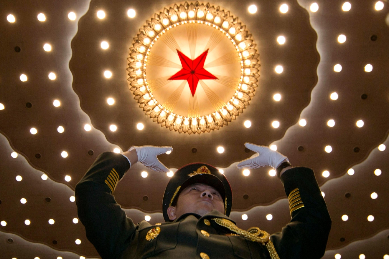 FILE - In this file photo taken Thursday, March 5, 2015, a military band conductor leads during the opening session of the National People's Congress at the Great Hall of the People in Beijing. Democracy Chinese-style will go on display when the country's rubberstamp legislature, the National People's Congress opens its annual sessions in Beijing on Sunday, March 5, 2017. (AP Photo/Ng Han Guan, File)