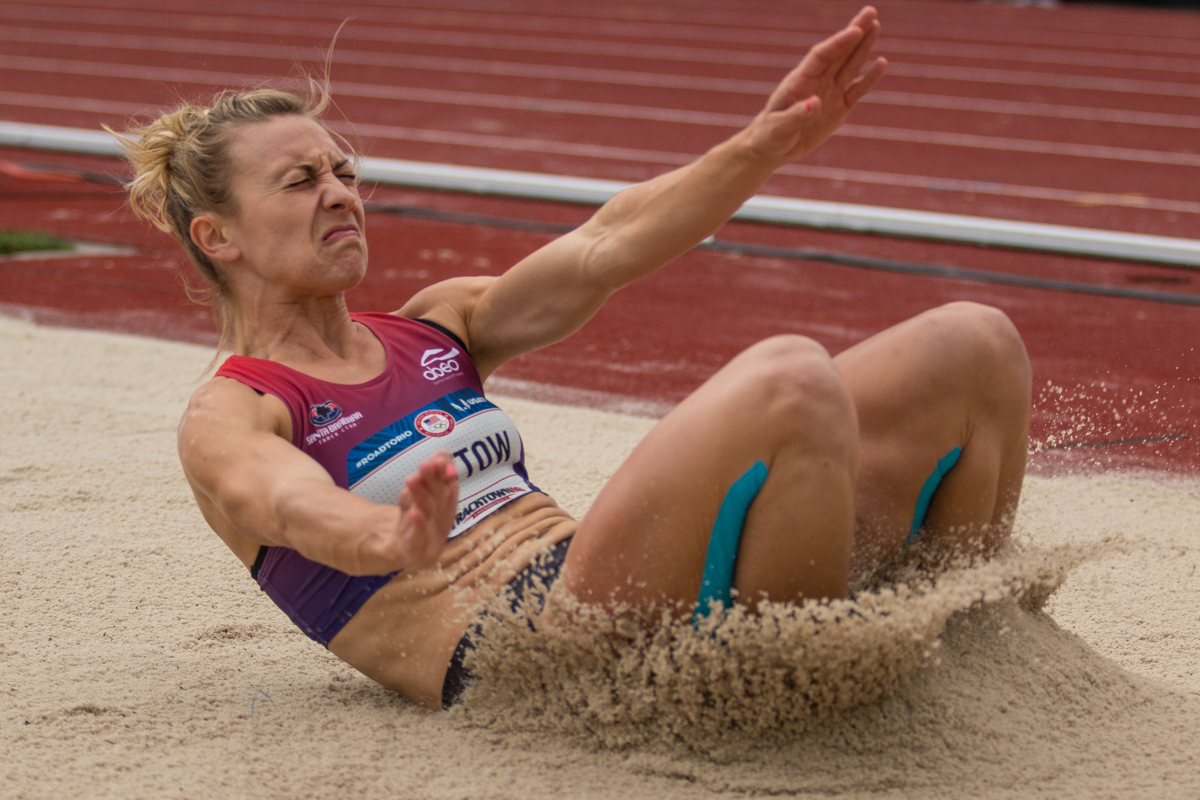 Lindsay Lettow falls into the sand pit during the long jump portion of the heptathlon. She placed 10th overall after two days of competition. Day Ten of the U.S. Olympic Trials Track and Field concluded on Sunday at Hayward Field in Eugene, Ore. Competition lasted July 1 - July 10. Photo by Dillon Vibes