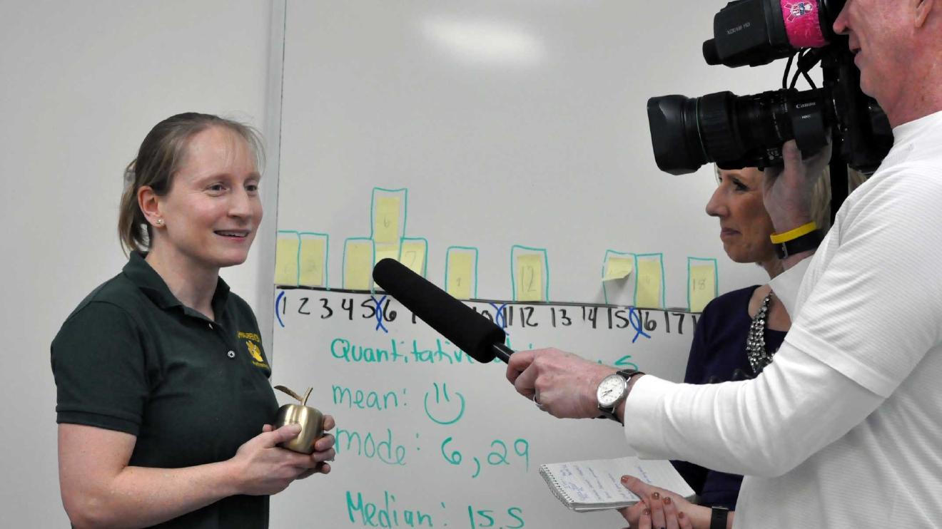 Golden Apple Award recipient Renee Stein is interviewed by FOX 11's Michelle Melby March 8, 2017, at Ashwaubenon High School. (WLUK/Donna Fischer)