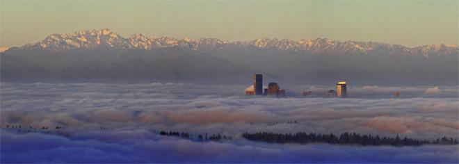 Sunrise over Seattle in fog -- (Photo: YouNews contributor: stephencobert)