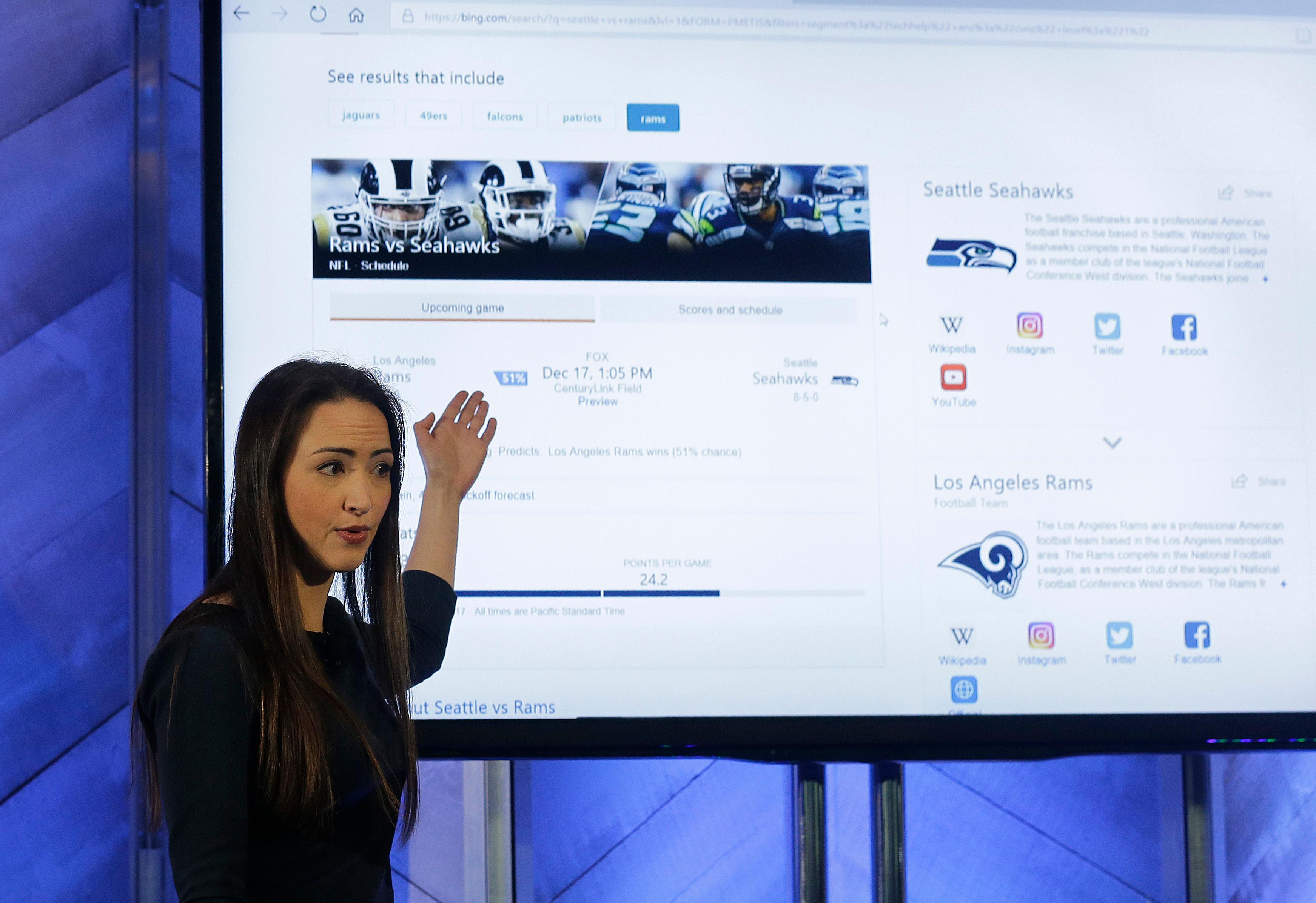 Kristina Behr, partner program manager for AI product design, gives a demonstration of new intelligence search features in Bing at a Microsoft event in San Francisco, Wednesday, Dec. 13, 2017. Microsoft rolled out new features on its Bing search engine powered by artificial intelligence, including one that summarizes the two opposing sides of contentious questions, and another that measures how many reputable sources are behind a given answer. (AP Photo/Jeff Chiu)