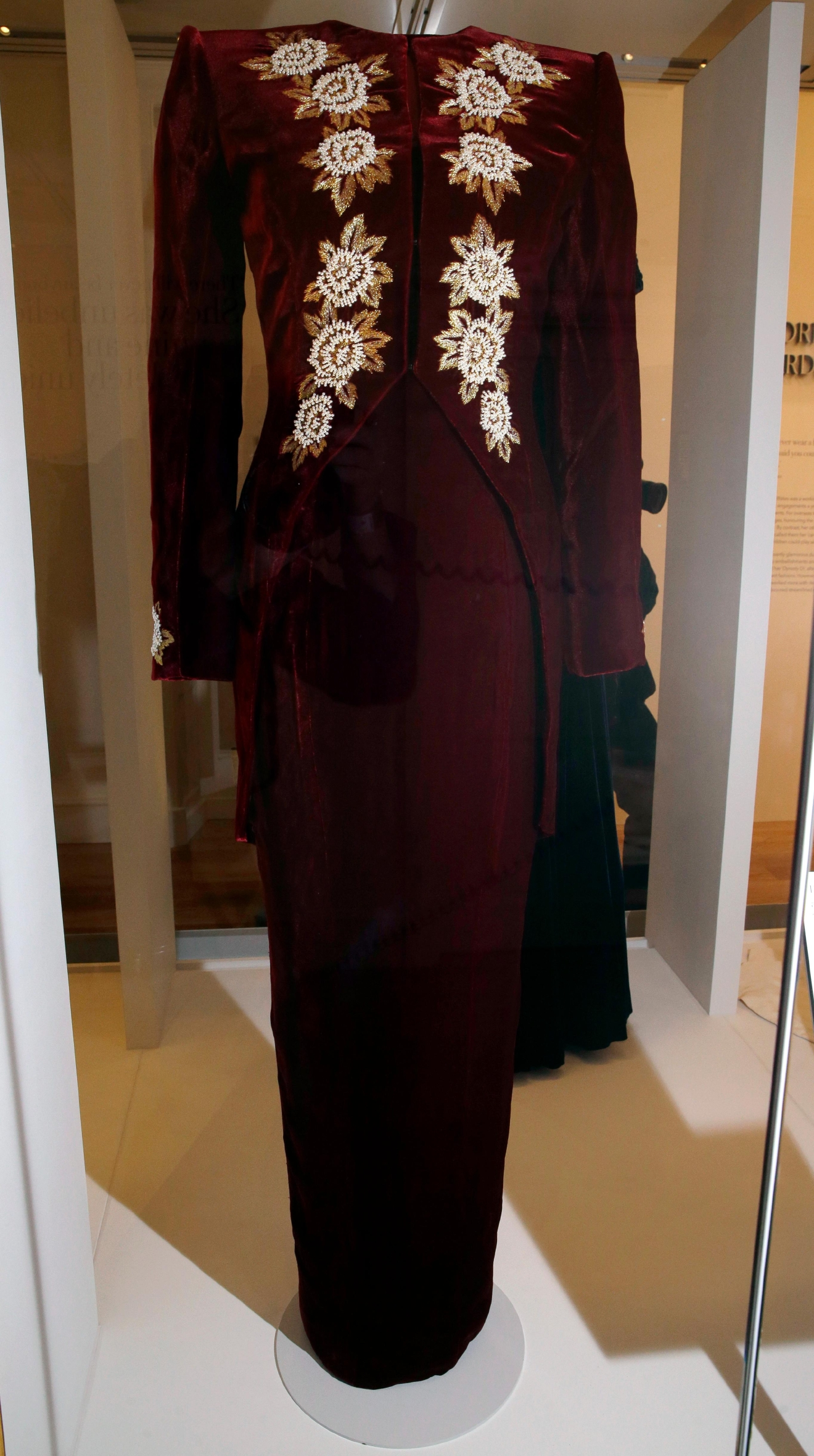 "A burgundy silk velvet evening dress by Catherine walker and worn by Diana, Princess of Wales in 1990 at a film premier and on an official visit to South Korea in 1992, is on display during a media preview of an exhibition of 25 dresses and outfits worn by Diana entitled ""Diana: Her Fashion Story"" at Kensington Palace in London, Wednesday, Feb. 22, 2017. (AP Photo/Alastair Grant)"