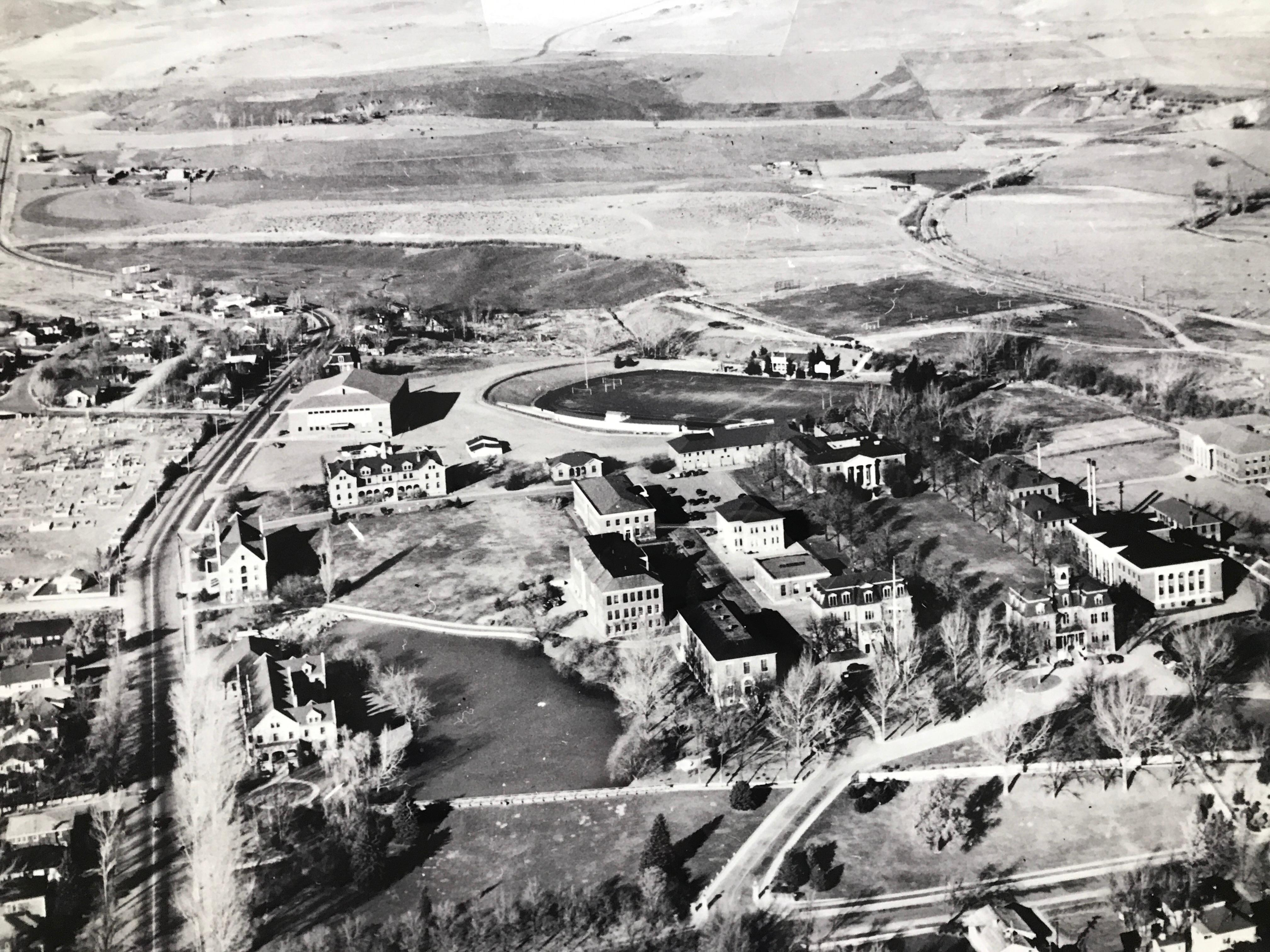 The quadrangle at the University of Nevada was modeled on Thomas Jefferson's design of the University of Virginia lawn. In this 1944 aerial view of the campus, the tree-lined quad is seen on the right with the Mackay School of Mines at the far end, and Morrill Hall (1886) in the foreground. (Photo courtesy: Nevada Historical Society)