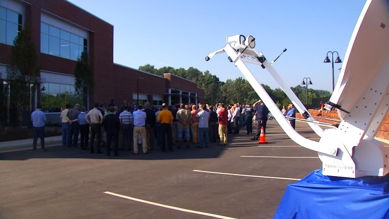 The scene on Wednesday when AvL Technologies held a ribbon cutting ceremony for its new 60,000 square foot manufacturing facility.  (Photo credit: WLOS staff)