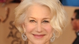 Flirty Helen Mirren flusters Stephen Colbert with kiss