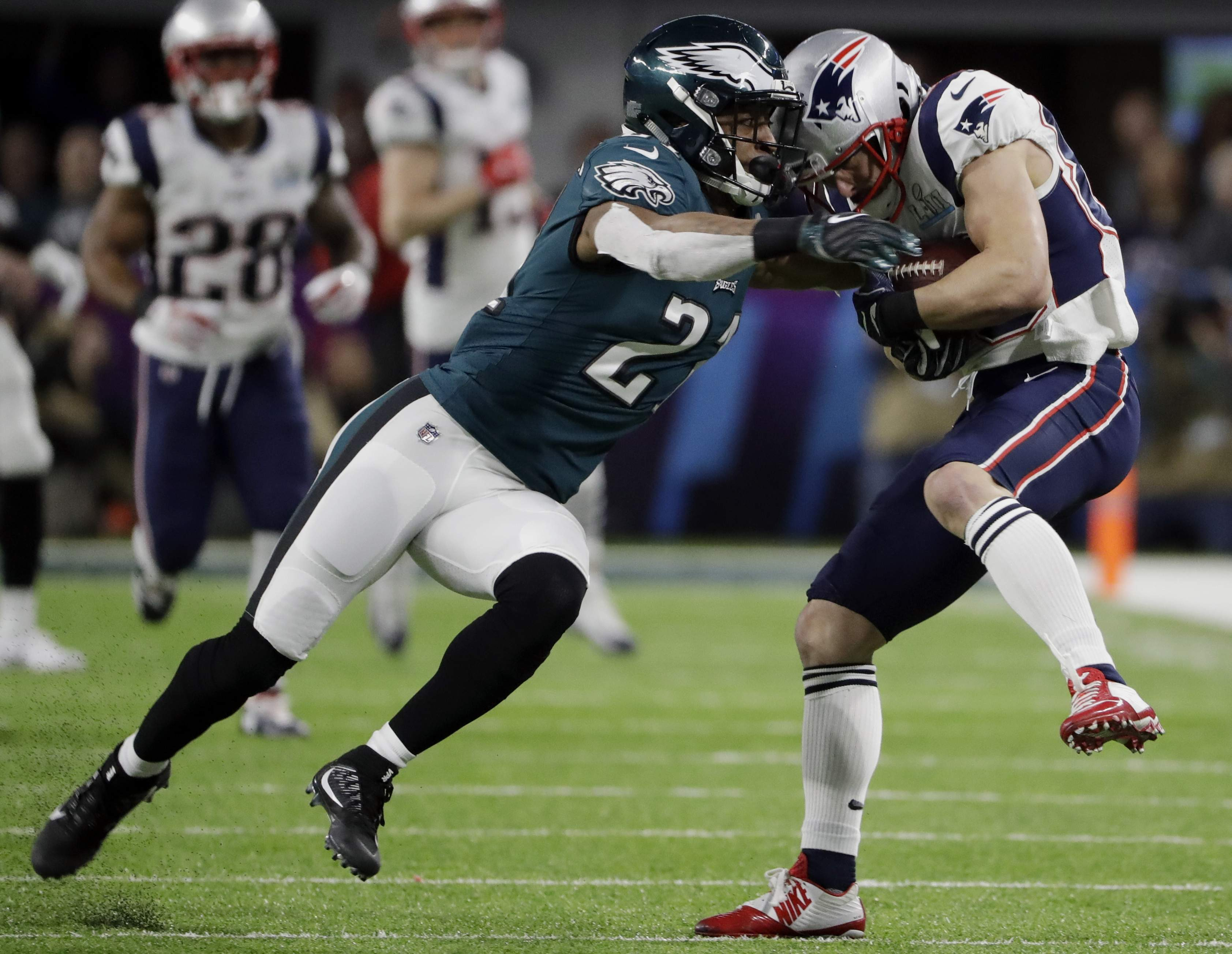 Philadelphia Eagles cornerback Patrick Robinson (21), tries to tackle New England Patriots wide receiver Danny Amendola (80), during the first half of the NFL Super Bowl 52 football game, Sunday, Feb. 4, 2018, in Minneapolis. (AP Photo/Chris O'Meara)