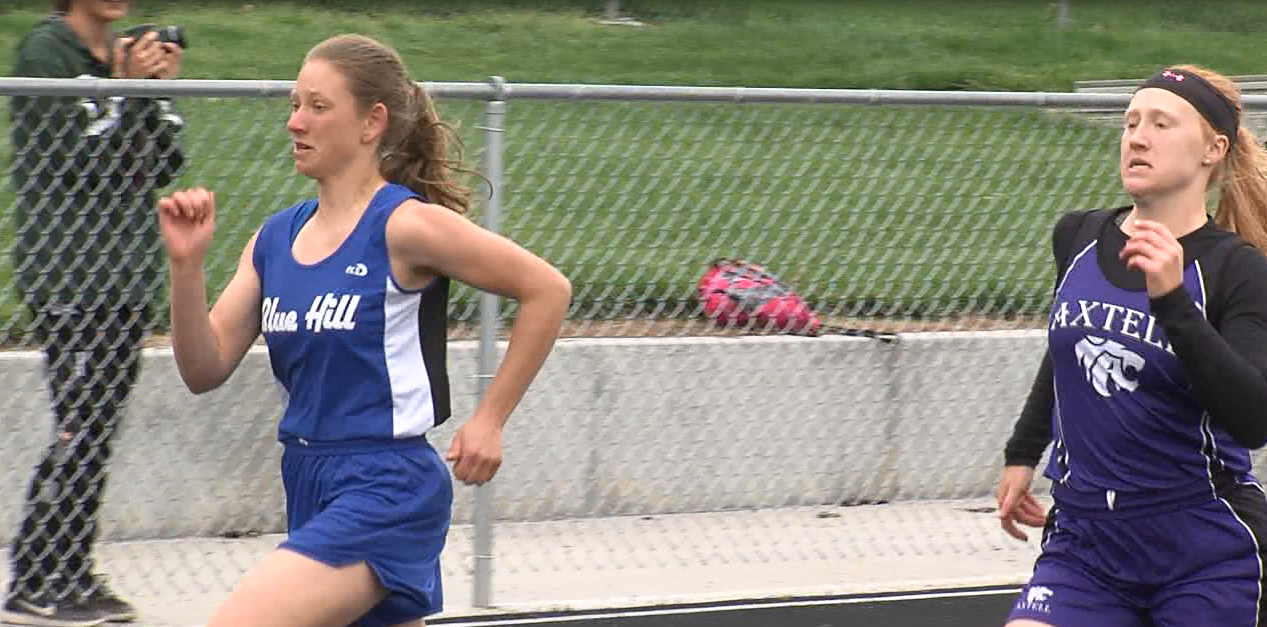 Kenzie Hubl (left) separates from Axtell's Regan Miller in the girls 100 M dash, May 10, 2017, at the D8 district meet (NTV News)
