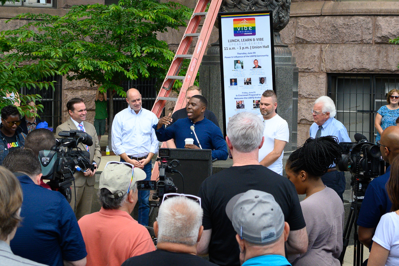 On Friday, June 21, City Council members Chris Seelbach, Tamaya Dennard, Jeff Pastor, Greg Landsman, Mayor John Cranley, and Assistant to City Manager Kelly Carr (among others) spoke at the raising of the Pride flag ceremony right outside City Hall. The raising of the Pride flag, which depicts every color of the rainbow, on City Hall's flagstaff was a first for Cincinnati, making the event a historic moment for inclusivity. June is LGBTQIA Pride month, and the flag symbolically shows acceptance for all Cincinnatians at the beating heart of the city's local government. Roughly 150-200 people of all ages attended the event, which lasted approximately 30 minutes. / Image: Phil Armstrong // Published 6.21.19