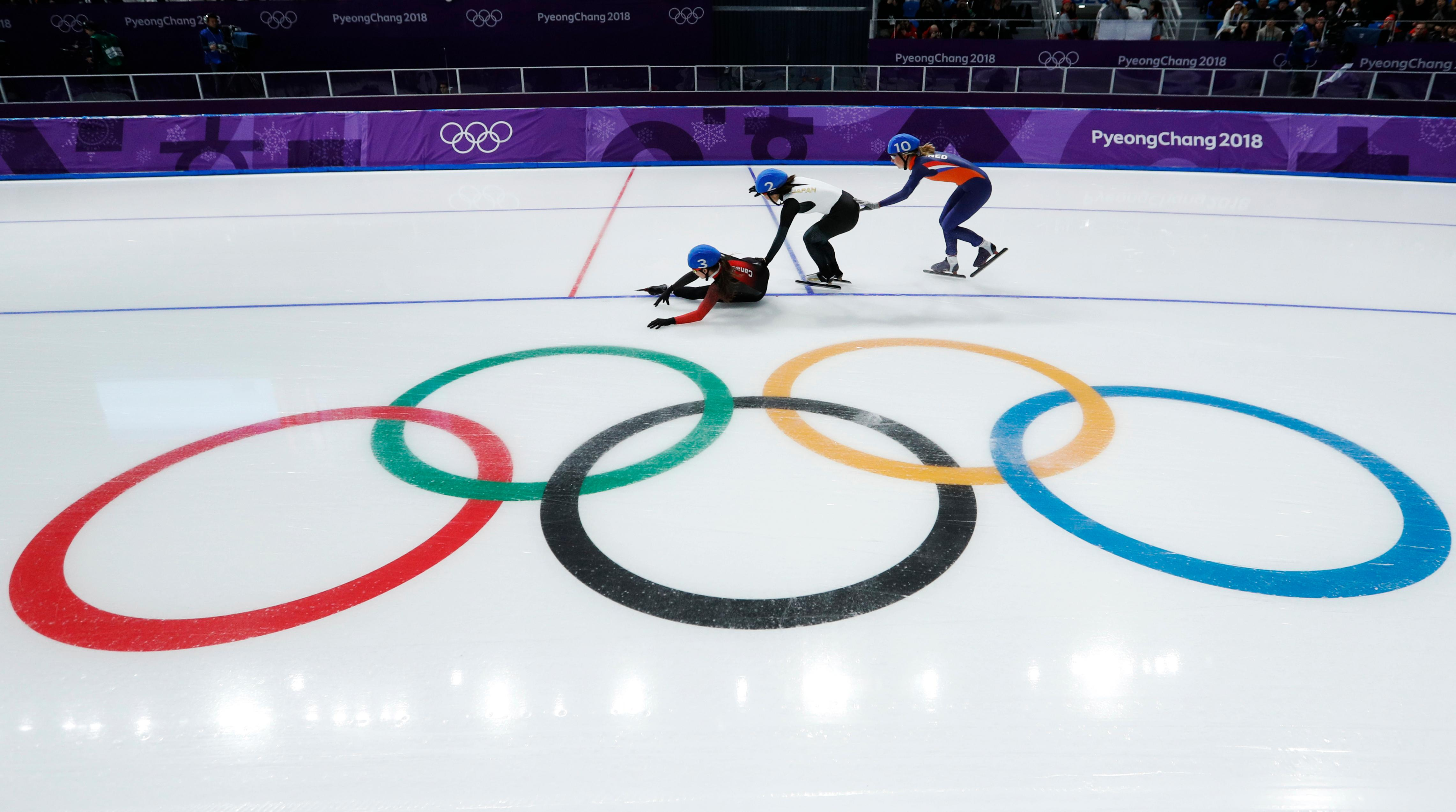 Ivanie Blondin of Canada, Ayano Sato of Japan, and Annouk van der Weijden of The Netherlands, from left to right, crash during the women's mass start semifinal speedskating race at the Gangneung Oval at the 2018 Winter Olympics in Gangneung, South Korea, Saturday, Feb. 24, 2018. (AP Photo/John Locher)