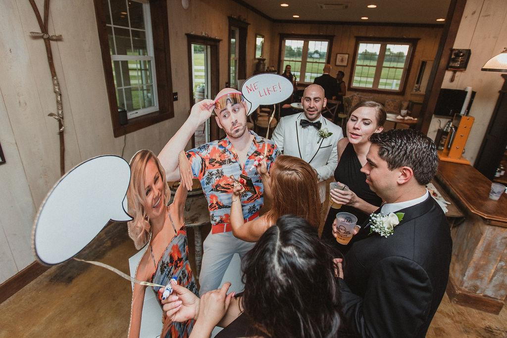 """We love to play dress up so we had life size cut outs made of us wearing matching Hawaiian outfits. The cut outs had word bubbles for guests to write on,"" said Summer. (Image: Chris Ferenzi)"
