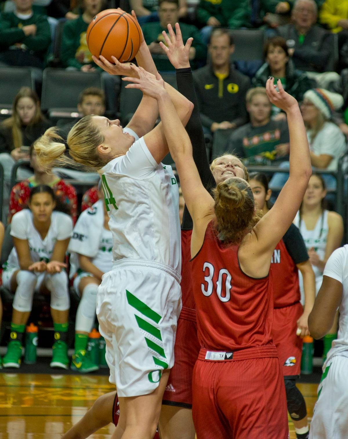 Oregon Ducks Mallory McGwire (#44) draws a foul from Southern Utah Thunderbirds Carlie Jones (#30). The University of Oregon Ducks women basketball team defeated the Southern Utah Thunderbirds 98-38 in Matthew Knight Arena Saturday afternoon. The Ducks had four players in double-digits: Ruthy Hebard with 13; Mallory McGwire with 10; Lexi Bando with 17 which included four three-pointers; and Sabrina Ionescu with 16 points. The Ducks overwhelmed the Thunderbirds, shooting 50% in field goals to South Utah's 26.8%, 53.8% in three-pointers to 12.5%, and 85.7% in free throws to 50%. The Ducks, with an overall record of 8-1, and coming into this game ranked 9th, will play their next home game against Ole Miss on December 17. Photo by Dan Morrison, Oregon News Lab