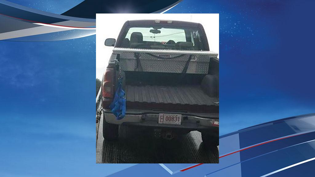 A fallen soldier's mom is searching for her maroon 2003 Chevy Silverado HD 2500 Duramax diesel truck that had no tail gate, a blue nylon web net on the back, tinted windows, a tool box, and a fallen soldiers symbol on the rear passenger side window. (KOMO News){ }