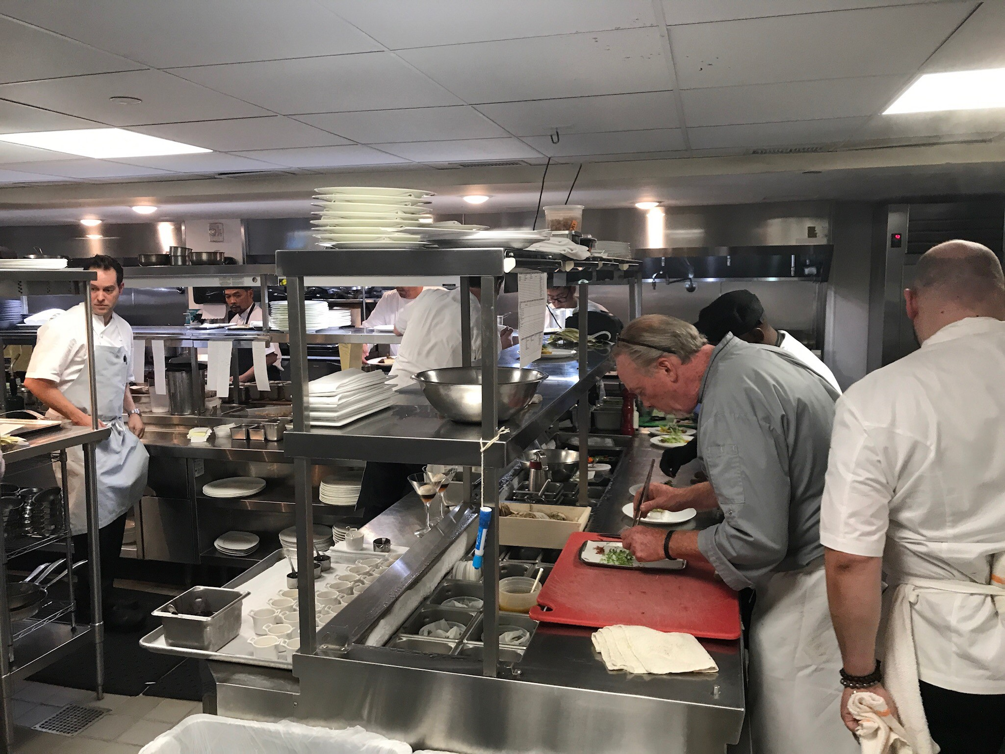 Chefs Michael Santoro and Brian McBride prepping for the evening in the kitchen at Kingbird. (Image: Courtesy The Watergate Hotel)