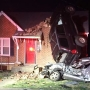 Driver taken to hospital after crashing into vehicle, ending upright against home